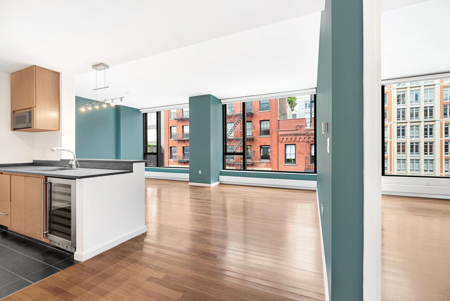 "SOHO condo which easily converts to 2-bedrooms! 9'6"" ceilings, huge windows with Eastern exposure in premiere luxury building!This serene apartment has central A/C, and Washer/ Dryer in the unit and a Video/ Intercom messaging system.Additionally, there are beautiful hardwood floors, exceptional closet space, open kitchen with Fisher Paykel range, Bosch dishwasher, Sub-Zero fridge, wine fridge and garbage disposal. The marble bath has a deep, oversized soaking tub.505 Greenwich Street features a 24-hour doorman/ concierge, fitness center, pet spa, zen-meditation garden, children's playroom, bike storage and private resident storage. Situated between the Hudson River, Tribeca, the West Village and prime SoHo!"