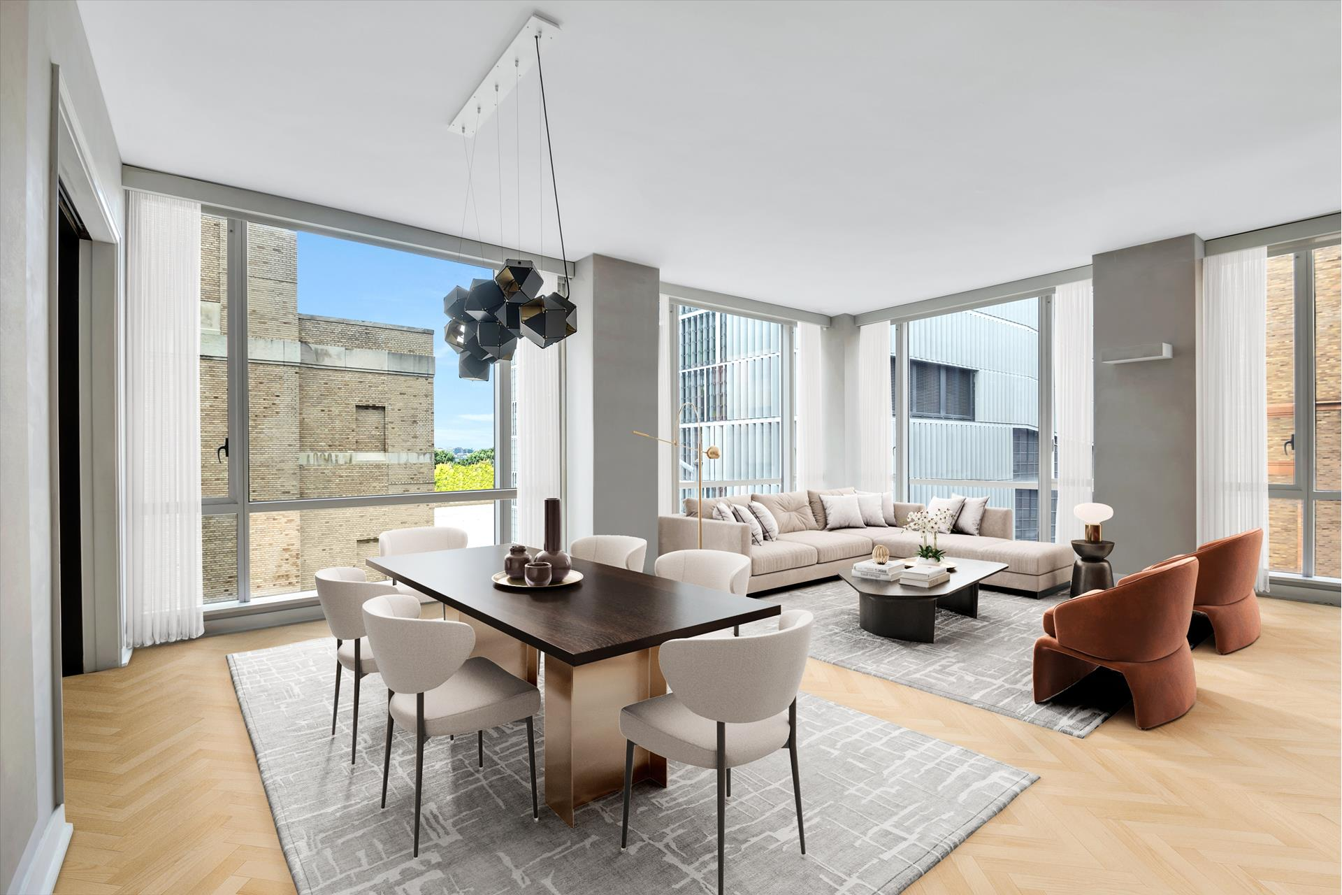 A bright corner condo nestled just a block away from the Hudson River Greenway, this 4-bedroom, 4.5-bathroom home is an exemplar of contemporary city luxury. Features of this 2,309 sq. ft. apartment include gorgeous white oak herringbone floors, soaring 10-ft ceilings, central heating and cooling, wall-to-wall floor-to-ceiling windows with northern and western exposure, and a convenient in-unit washer/dryer. Beyond a tasteful foyer adorned with a powder room and a walk-in coat closet, the home flows into an expansive, open-concept living room, dining room, and kitchen. The living and dining spaces are saturated with natural light, and the custom Bulthaup kitchen is equipped with a massive eat-in island, sleek countertops, and a suite of high-end stainless-steel appliances from Viking, Miele, Sub-Zero, and Kuppersbusch.The master suite sits behind the kitchen and possesses northern exposure, a spacious dressing area with custom built-ins, a wall of reach-in closets, and an immaculate en-suite bathroom with dual vanity sinks, radiant heated flooring, a walk-in shower, and a deep soaking tub. Each of the remaining three bedrooms has private closet space, western exposure, and full en-suite bathrooms.The Urban Glass House is a full-service condominium located in Hudson Square. The building has a 24-hour doorman, a super, bicycle storage, a private gym with a yoga room, and private storage bins. It is just a few blocks from all the restaurants, bars, cafes, and shops of Greenwich Village, SoHo, and Tribeca, and is close to Piers 40 and 45 as well as the Hudson River Greenway. Nearby subway lines include the 1/2/C/E. Pets are welcome.