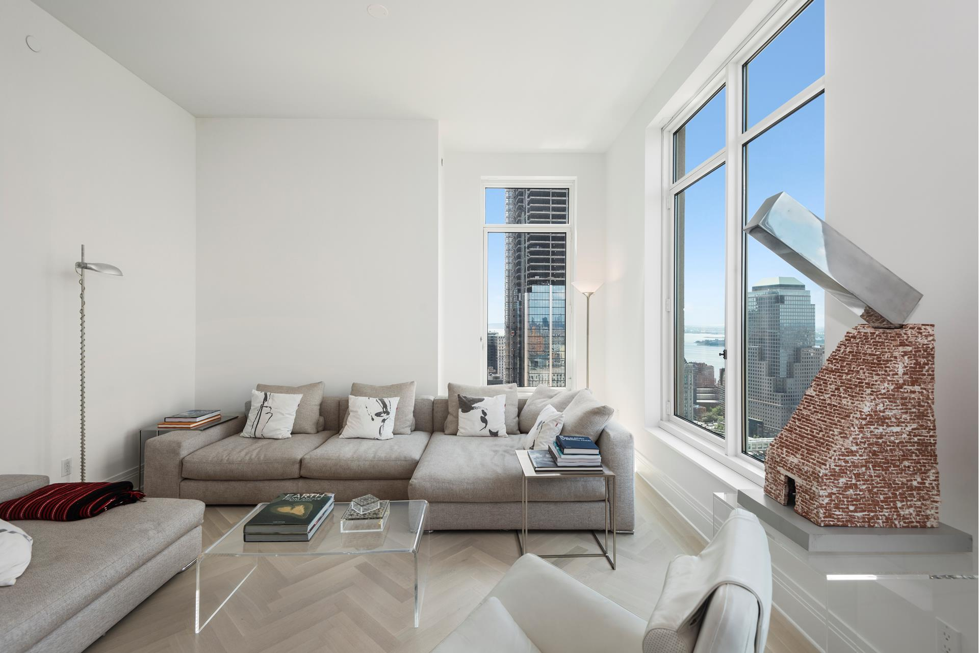 NOW AVAILABLE SHORT TERM 6 MONTHS AS WELL AS LONG TERM. LIVE IN THIS GRAND HIGH FLOOR CORNER THREE BEDROOM HOME AT THE LUXURIOUS FOUR SEASONS PRIVATE RESIDENCES IN DOWNTOWN MANHATTAN. SWEEPING WORLD TRADE CENTER VIEWS SOUTH AND HUDSON WATER VIEWS WESTS TO WATCH SUNSETS AT COMFORT OF YOUR OWN HOME. THE FOUR SEASONS OFFER TOP OF THE LINE FIVE STAR SERVICES AND WORLD REKNOWNED AMENITIES INCLUDING 75 FT. LAP POOL AND FOUR SEASON'S SPA. IT IS ALSO CURRENTLY THE TALLEST RESIDENTIAL BUILDING TO GRACE THE DOWNTOWN SKYLINE AT 926 FT. HIGH..Welcome to this stunning, south and west facing three bedroom home. Formal foyer leads to the corner open living and dining room with fantastic light and unobstructed sunset views. Beautifully appointed master bedroom suite faces west with luxurious master bath featuring two vanities, glass enclosed shower, and freestanding soaking tub. Second bedroom is equally grand with corner views south and west. Chefs galley kitchen is perfect for cooking in privacy and entertaining.  Interior finishes include solid oak wood flooring with herringbone pattern in the formal rooms, Bilotta rift-cut oak kitchen cabinetry, Gaggenau appliances, marble bathrooms with Robert A.M. Stern custom-designed vanities. This home is equipped with Lutron electric shades (blackout and solar shades in bedrooms and solar shades in living/dining room, and added light fixtures throughout. Life at the Four Seasons Residences will offer residents ability to use hotel a-la-carte services including in-room dining, maid, and concierge services (aside from condo bellman and concierge) for additional fee. Developed by visionary Silverstein Properties, Inc. Masterfully designed by Robert A.M. Stern Architects. Enjoy 5-star living with access to the Four Seasons Hotel amenities including spa with sauna and steam rooms, professional salon, swimming pool, attended parking garage, Wolfgang Puck's CUT restaurant, bar and lounge, ballroom facilities, and meeting rooms, as well as a comp