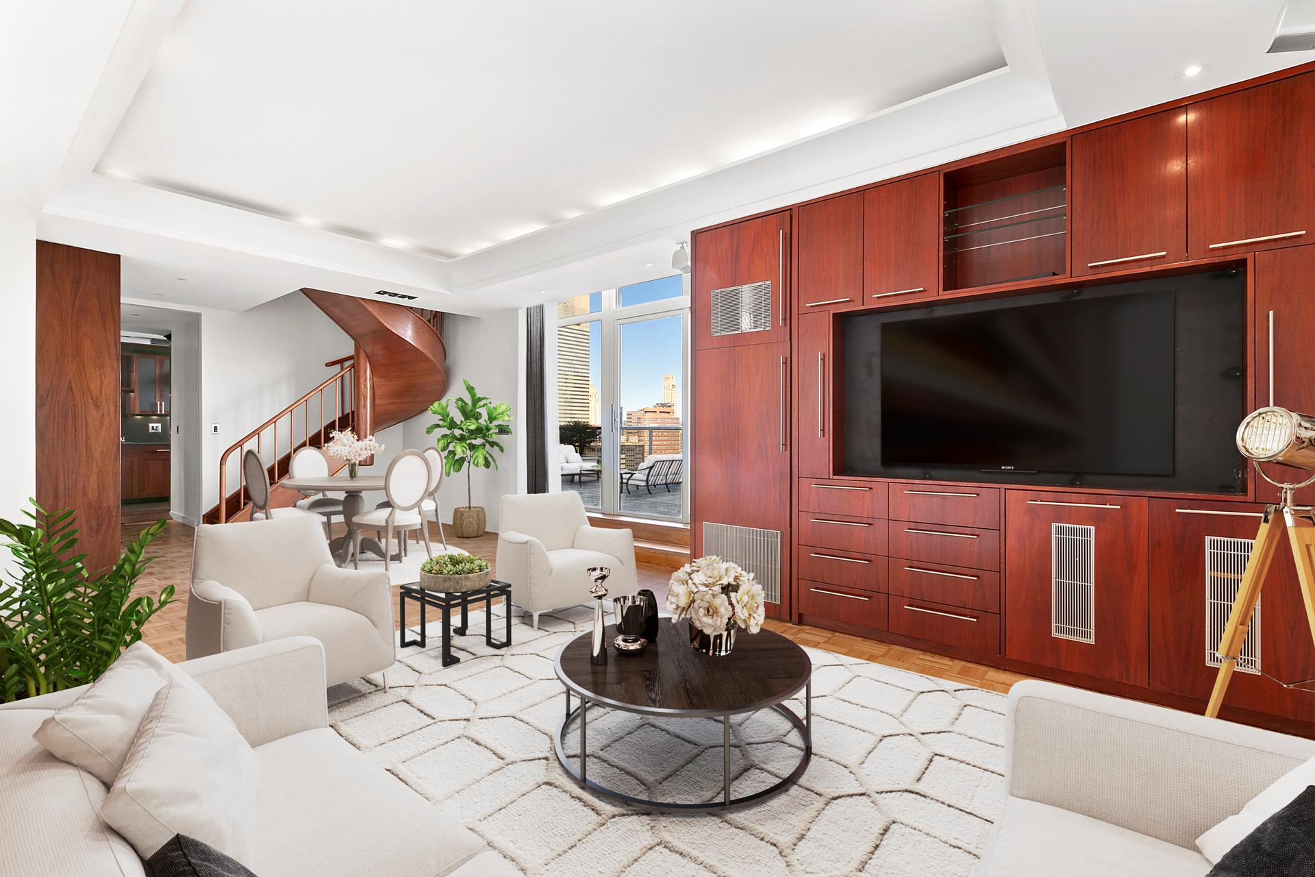 Open House on Saturday 09/19 and Sunday 09/20 from 12-4 BY APPOINTMENT ONLY. This Stunning Mint Condition Duplex Penthouse with spectacular East River, bridge and City views has a private 370 square foot terrace and is perfect for entertaining. No detail has been overlooked and all upgrades are of designer quality. The 44th Floor foyer leads you into a comfortable living room / dining room which has a professional Wine Cooler, access to the huge terrace and a powder room. The State of the Art Kitchen has a window, a breakfast bar and all appliances are Viking-Professional and include an oversized refrigerator, a separate ice-maker and a six burner stove. An impressive staircase takes you to the 45th floor. Both the master & second bedrooms have oversized windows with amazing views of the Manhattan skyline and the East River. The closet space is unique and it includes walk-ins and a wall of shoe closets. The master bathroom has two sinks and both a tub and a shower. The second bath is large and is en-suite to the second bedroom. 100 United Nations Plaza is a White Glove Full Service Building, with a 24/7 concierge & doorman, has an attended Health Club and a conference/party room. Photos are virtually staged.