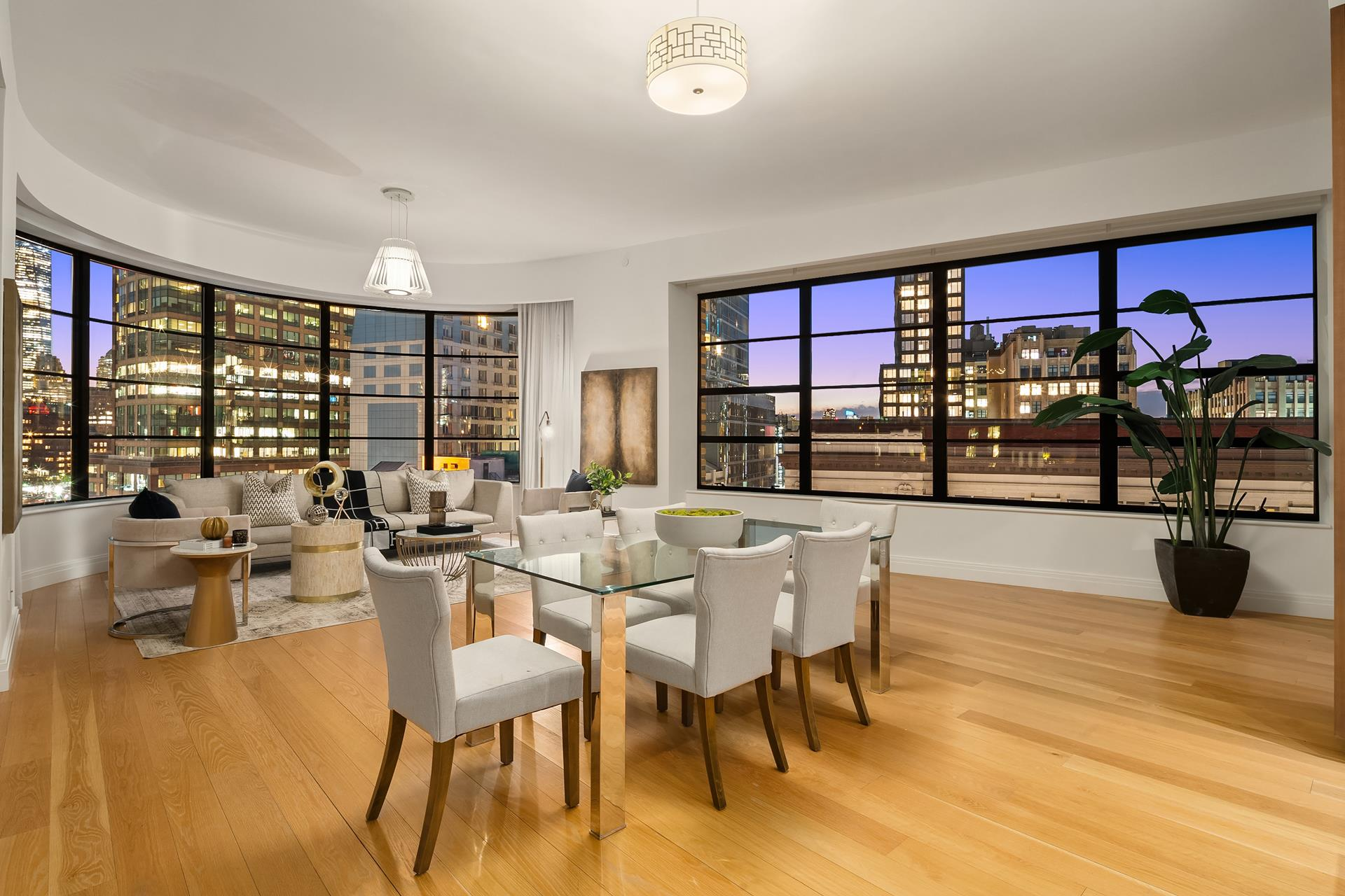 This 2,950-square foot 3-bedroom, 3.5-bath full-floor residence, with 404 square feet of private outdoor space, graces the signature south-facing prow of 10 Sullivan Street, where curved walls of oversized windows offer exceptional southern light, revealing   breathtaking Downtown panoramas. The private balcony provides substantial outdoor space with open northern city views. Beyond the residence's private elevator vestibule, a formal entry foyer leads to a central gallery, ideal for showcasing art, and then to   a magnificent great room with soaring 11' ceilings and three walls of floor-to-ceiling windows. The adjoining open Poliform kitchen with center island breakfast bar is appointed exquisitely with handsome walnut cabinetry and Lagano marble slab countertops   and backsplash, with top appliances by Sub-Zero, Miele, and Viking. The private master suite offers a generous walk-in closet and massive, windowed master bath, complete with motorized window shades. Elegantly clad in Dolomite white marble, this master bath   features a Macassar Ebony Poliform double vanity with Lefroy Brooks fixtures, freestanding soaking tub, separate steam shower, private water closet, and radiant heat floors. Two additional bedrooms are generously proportioned, each offering west-facing exposures   and en-suite full baths. A powder room and laundry room with sink and side-by-side washer and dryer complete this magnificent residence. Modern conveniences abound, including a Savant home automation system and motorized window shades, and radiant heat flooring   throughout. A sumptuous palette includes oil-rubbed Danish oak floors and oversized industrial-style windows, distinctive interior finishes inspired by SoHo's rich aesthetic heritage.