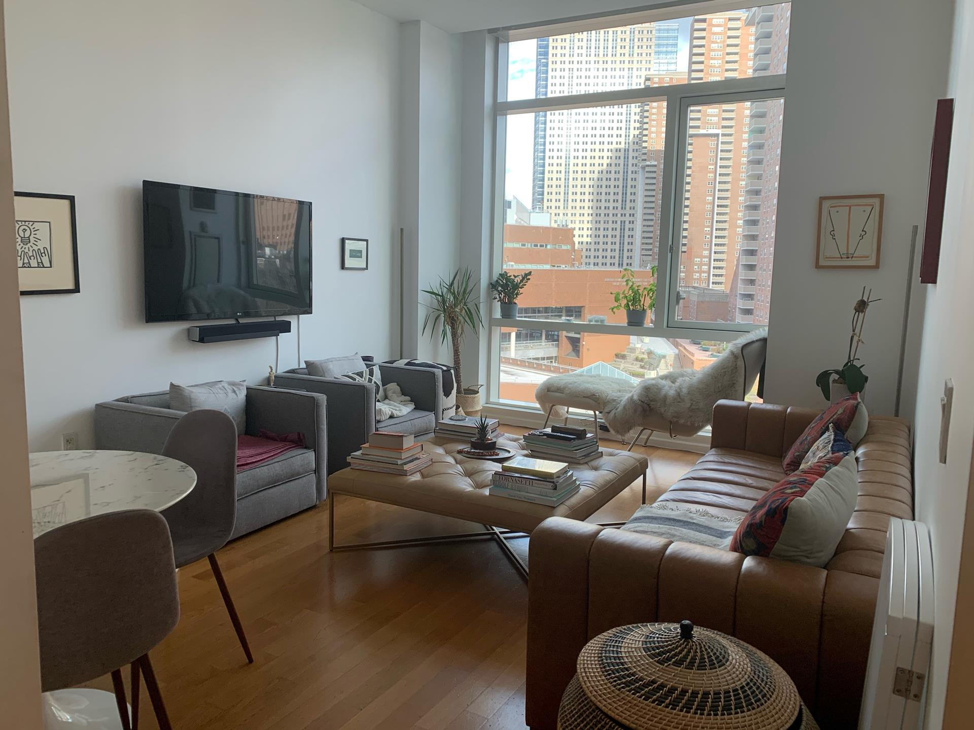 A one bed with 11 FOOT CEILINGS & open kitchen! This top of the line 7th floor apartment looks onto a water/bridge view as well as tennis court/park views. See trees & water from your living room and bedroom window in this super 5 star condo building  and all the amenities that it has to offer. A 50ft indoor heated swimming pool & gym as well as a 5,000 sq. ft. terrace where you can watch all the activity of TRIBECA! Don't forget this is a 24 hour doorman building  and is pet friendly. Be a part of Tribeca and experience 200 Chambers rent this today! This one will not last! Thank you for visiting our website and please come back. Brokers collect your own fee.