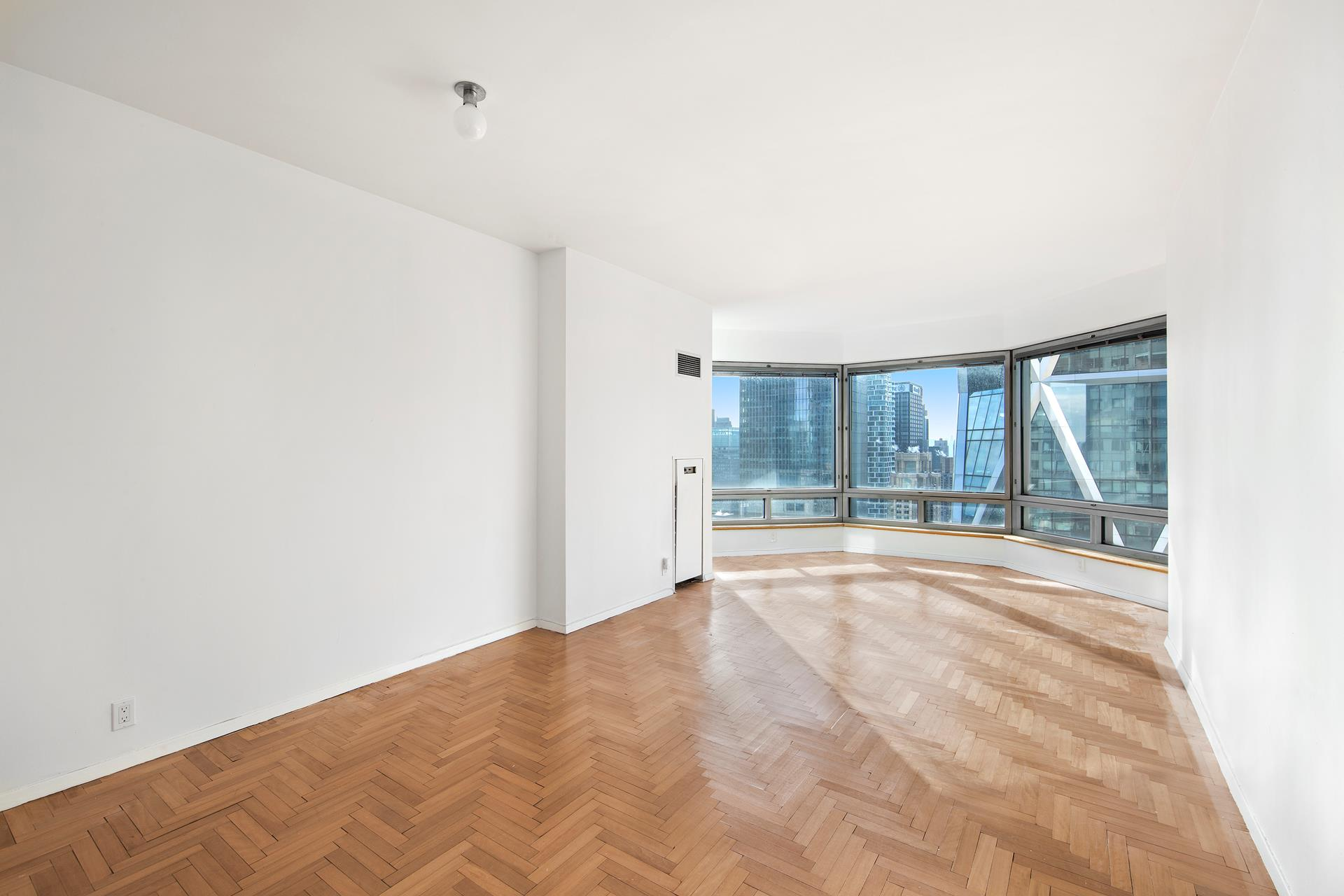 Stunning Billionaire's Row 1 Bedroom, 1.5 Bathroom with spectacular city and river views. The entrance hall leads you into an expansive south facing living room and dining area with oversized bay window overlooking the city and the Hudson River. Separate kitchen features stainless steel appliances and has an opening to the living room. The master bedroom features two closets and in suite marble bathroom. Ample closets, chevron hardwood floors and a half bath complete this home. The apartment also comes with a storage unit!The Central Park Place is one of Manhattan's most desirable condominiums. Services include a 24-hour doorman; health club with indoor swimming pool, sauna, boxing room, massage room, yoga room; terrace; renovated party room/lounge; overnight guest suites; and even a private entrance to subway.