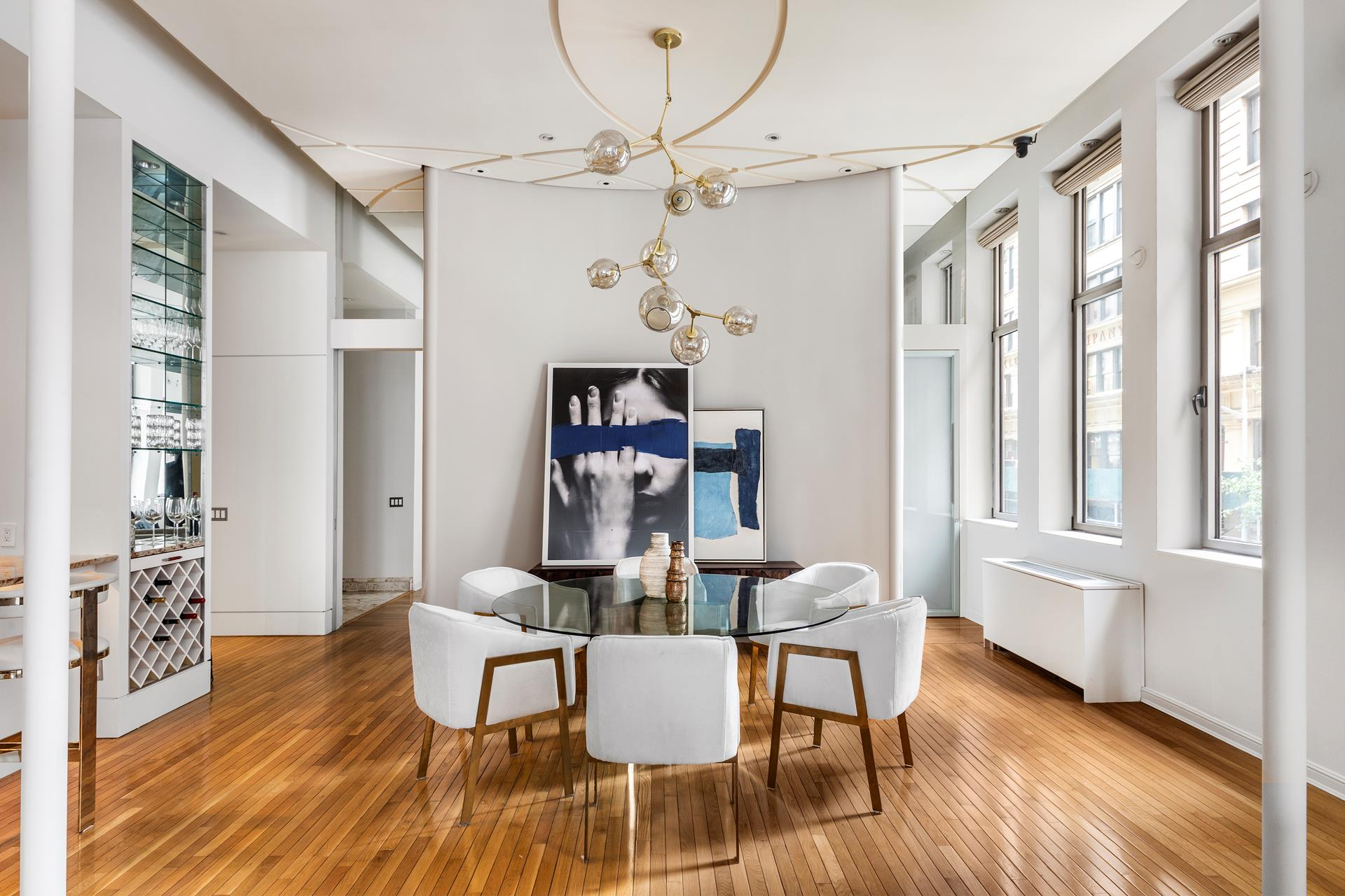 This spectacular 3-bedroom loft (currently configured as a two beds) is located in the Chelsea Mercantile, one of the most desirable prewar condominiums in the neighborhood.At 2,200 square feet this corner loft with over 13' ceilings and tall oversized windows, Apartment 3I is truly a unique offering of prewar elegance completed with modern design. A gracious entry gallery leads you into the massive living and dining area that creates a perfect entertaining space. The pristine hardwood floors throughout, generous built-ins, an abundance of natural light, and designer custom lighting for showcasing art are some of the features that make this apartment so special. There are two planting terraces off the north and west facing corners that allow for a unique opportunity to have an outdoor component in this loft home.The chefs-kitchen has Viking appliances, custom cabinetry, stone countertops, and storage for wine. The master suite includes three large closets and a walk-in as well as a five-piece spa bath with double sinks and separate soaking tub and an oversized shower. The split bedroom layout is ideal for privacy and use of space.Built in the early 1900s, The Chelsea Mercantile is a well-established full-service prewar condominium in the heart of Chelsea close to shopping, dining, public transportation, and the highline. Amenities include a beautifully renovated lobby, 24-hour doorman, live-in super, private storage, children's playroom, dry-cleaning services, gym, parking, and a 10,000 sqft planted/furnished roof-deck with unbelievable city views. In addition, there is a Whole Foods located at the ground level making grocery shopping more than convenient.