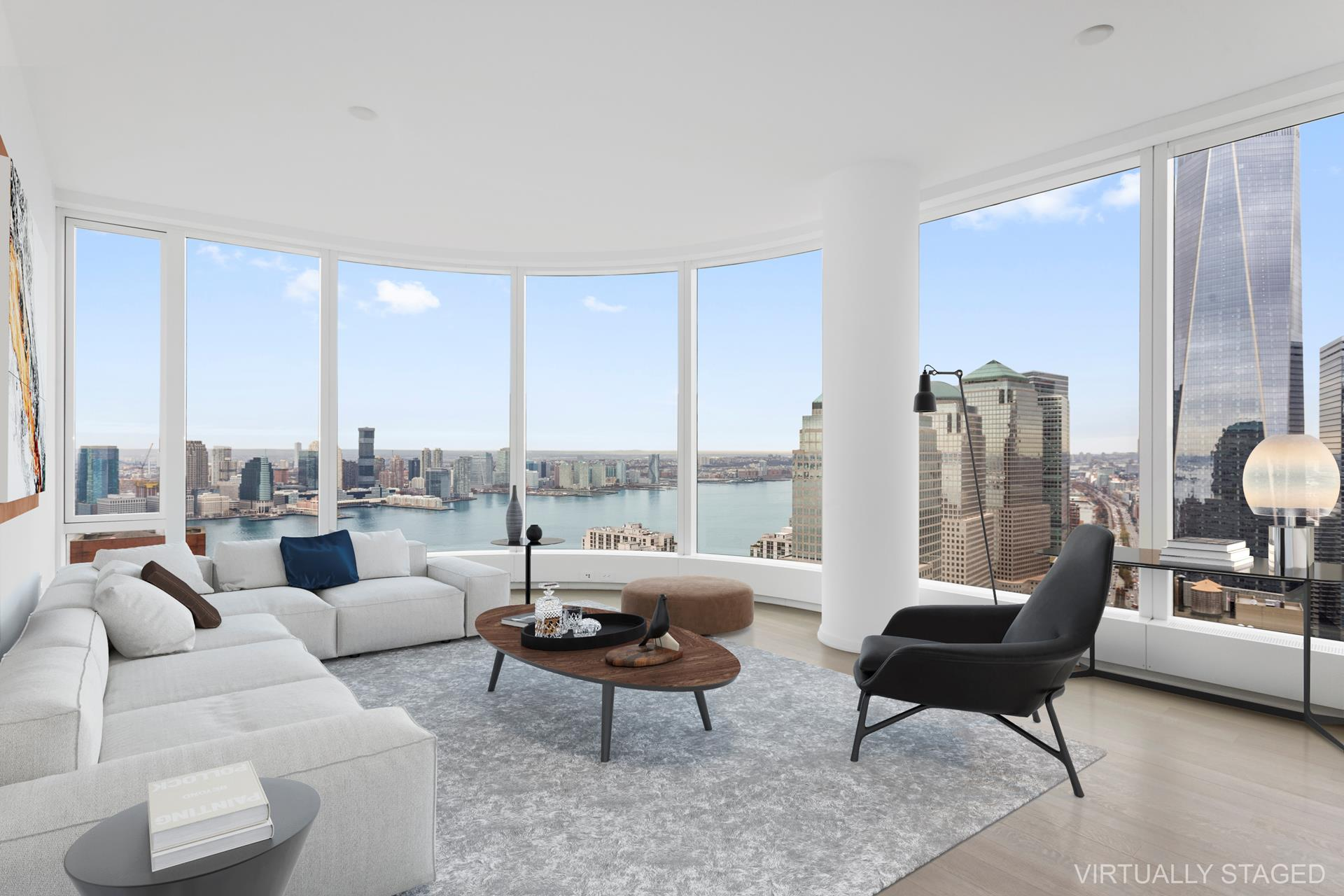 Experience this glorious high-floor home in one of the most luxurious residences, 50 West Street.Graced with stunning views of the Hudson River and the New York City skyline, this bright convertible 2-bedroom, 2-bathroom condo blends a collection of high-end finishes with a contemporary open plan layout. Features of this 1,258 sq. ft. home include an in-unit washer/dryer, open plan layout, northern and western exposure, beautiful hardwood floors, gorgeous curved floor-to-ceiling windows, and an elegant entry foyer leads to spectacular living space with an open kitchen which is designed with custom stained walnut cabinetry, granite countertops, and a waterfall island.Past a formal entryway foyer that's adorned with its own closet the home flows into a radiant, open-concept living room, dining room, and kitchen. The living and dining space possess tremendous views of the river and the World Trade Center. The kitchen is equipped with sleek countertops, a huge eat-in island, beautiful cabinetry, and a suite of fully-integrated stainless steel appliances. The master bedroom features skyline and river views, a pair of closets, and a sublime en-suite bathroom with dual vanity sinks and a glass-enclosed walk-in shower. Just across from the master is an absolutely immense walk-in closet/dressing room. The space boasts north-facing windows and built- in clothing racks. 50 West Street is a 64-story luxury condominium designed by renowned architect Helmut Jahn. The building features a host of high-end amenities that include a full-time doorman, a 24-hour concierge, a series of children's playrooms/recreation spaces, a massive fitness center with a golf simulator and a spin studio, an extensive entertainment suite, a rooftop observatory with commanding 360-degree views, and the spa-like amenities of the Water Club.50 West Street is surrounded by unprecedented conveniences and access to the outdoors. Easy access to 1, 4, 5, R, and W subways, Eataly, Le District, and the soon-to-b