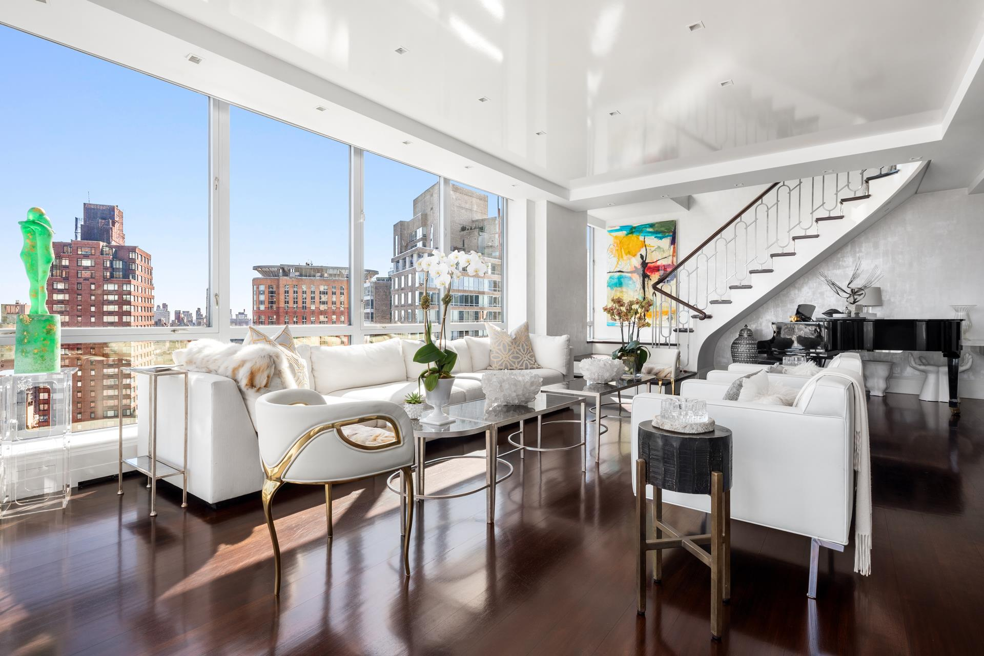 Spectacular, high floor Condominium Apartment with extraordinary, open City and Central Park views. At approximately 4,800 square feet and in mint condition, this beautiful home was renovated to the highest standard and is flooded with light from North,   East and South exposures.     Enter the Gallery to the Living Room, with Central Park views, and the Formal Dining Room with a double-sided fireplace. The exquisite Wood-Paneled Library or 5th Bedroom has a full bath en-suite. A Peloton and a treadmill are both cleverly hidden here as well.    The enormous Eat-in Chef's Kitchen with top-of-the-line appliances provides another warm and wonderful gathering place. Off the kitchen is the Laundry Room, with an oversized vented washer/dryer.    The dramatic staircase in the Living Room leads to the 2nd floor and into the glamorous Primary Bedroom Suite, with floor-to-ceiling windows, side Central Park views and a gas fireplace. The Primary Bathroom is done entirely in White Onyx with a double vanity,   soaking tub and large walk-in shower - a true sanctuary. The suite is completed by spacious windowed Dressing Room.    The upstairs hallway is lined with closets and leads to 3 additional Bedrooms and 3 additional Bathrooms.    No detail was overlooked in designing this magnificent home. The apartment features Central AC, a Creston Smart Home System, and seamless and exceptional craftsmanship throughout with marble and mosaic tile.    Located in the heart of Lincoln Square, the Grand Millennium provides its residents with a 24-hour doorman, a concierge, and a live-in resident manager. Central Park, Columbus Circle, Lincoln Center, Time Warner Center, Equinox Sports Club, upscale shopping   and dining are all easily accessible. The building needs 48 hours' notice before appointments.