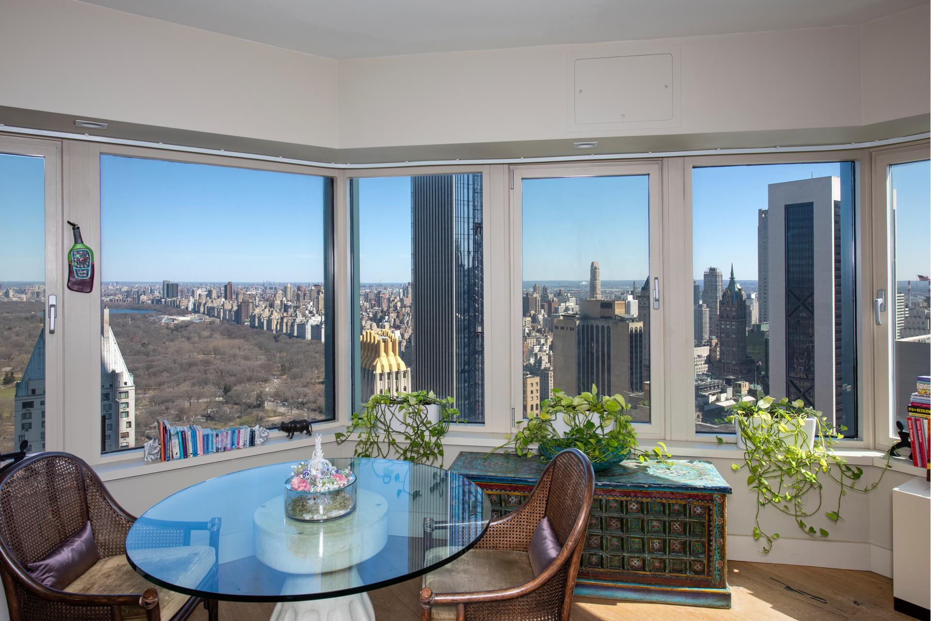 Breathtaking views from this one of a kind condo! 4802 is a meticulous property North/East/West views of the New York City Skyline, as far the eye can see .As you enter the foyer of this turn-key residence you are immediately struck by the beautiful oak   flooring. At 851 SF this 1 bedroom, 1.5 bathroom luxury condominium is drenched in light and offers an abundance of living and dining, the main bedroom has wonderful park views and lots of closets. The designer kitchen comes equipped with a Miele Fridge, Miele   Microwave, Imported German lacquer cabinets, granite countertops, Miele oven, Liebherr Dishwasher. The kitchen is completely open to the wonderful central park views. Cityspire is parallel to Billionares Row. It features a brand new fitness center, swimming   pool, sauna and steam room, playroom, palates room, conference room, brand new hallways with top of the line carpets and wall paper. garage in building. Be catered to by a premier concierge service, white glove doorman. Living at Cityspire is to experience   a wonderful life. Cityspire is located in Midtown West steps to Central Park, Columbus Circle, 5th Avenue, Theater District, Carnegie Hall & Time Warner Center. An absolute MUST SEE!!!!! assessment $ 125 ,reserve fund $50