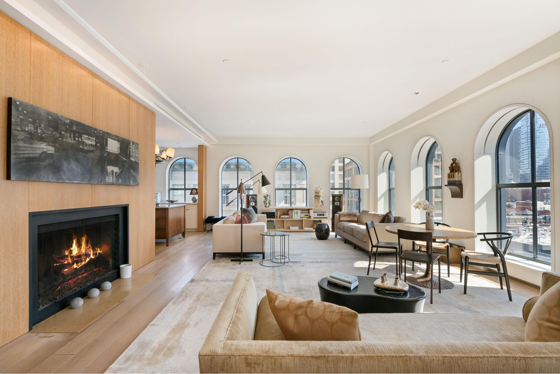 """Welcome to 408 Greenwich Street - Steven Harris Architect designed home of elegance and sophistication.    Offered for the first time in TriBeCa's Northern Historic District, moments from the Hudson River Park, this extraordinary Penthouse is a rare combination of space, light, dramatic views and excellence in design. This residence offers two exceptional full floors   including one of the most beautifully landscaped terraces in TriBeCa.    The level of finishes throughout are of the highest quality, beginning with the Jean Prouve' inspired entry doors of bronze and glass which welcome you from the keyed elevator into an elegant entry gallery. Materials in the foyer gallery and living areas include   Cerused Oak walls, Corian walls and 8-inch Siberian Oak flooring. From the foyer you walk in to the expansive and dramatic 40-foot-long living/dining room flooded with light from 11 oversized arched windows facing south and east overlooking lower Manhattan.    408 Greenwich offers unparalleled downtown Manhattan views along Greenwich Street. Morning, midday and evening, this residence offers spectacular views rich in color and dazzling city lights.    Designed to the highest standards this full floor duplex boasts 10'+ ceilings, 36 arched windows, all with Lutron controlled shades, 4 bedrooms, 3.5 baths, 4,222 interior SF, over 1,500SF outdoor space plus Media Room off the roof terrace.    There are 8"""" wide Siberian Oak radiant heated floors throughout the entire residence. The living room also features a gas burning French limestone fireplace.    The open chef's kitchen, efficient as it is beautiful, featuring custom Corian cabinetry, 2-inch-thick Imperial Damby marble countertops and an imported French volcanic lava stone island that includes an overhang for barstool seating, with French limestone   floors. For the ultimate in cooking enjoy a La Cornue Chateau 120 dual fuel range, 2 SubZero refrigerator drawers, and an oversized farmhouse Shaw's Original porcelain sin"""