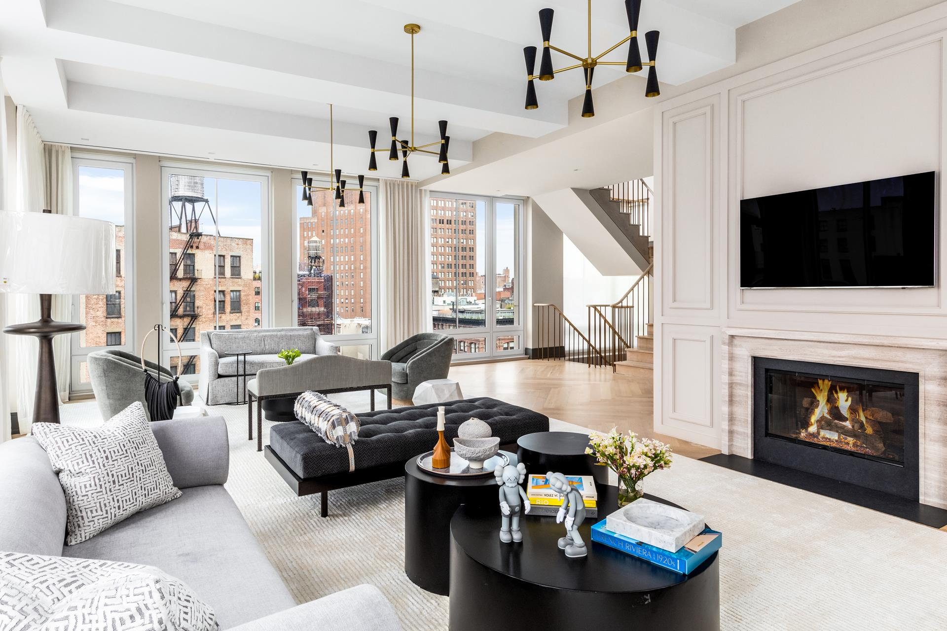 Located on a quiet stretch of road just moments from the finest restaurants, world-class shopping, and high-end art galleries lining Tribeca's uncrowded streets, this charismatic 7,261 SF+/- residence includes 6 bedrooms, 6 full and 1 half bathrooms, completely custom finishes throughout, iconic city views, three balconies, and a private rooftop, plus unbeatable amenities-the is an incredible opportunity to own one of just seven units in a building that offers on-site parking, a 24-hour gym, and 24-hour doorman.A true rarity, this fully customized contemporary haven boasts unparalleled access to the outdoors with not one but three spacious balconies facing two directions and an expansive private rooftop terrace..24 Leonard Street offers everything you desire in a city home, including an automated onsite parking garage where one can purchase or rent unlimited parking spots and over 9,000 SF+/- of breathtaking indoor/outdoor living space.Luxurious amenities like a private elevator lobby and state-of-the-art security system ensure peace of mind, while recessed lighting and sophisticated, mid-century chandeliers throughout the penthouse cast a warm glow over every custom-dressed interior space.White oak herringbone floors carry you from one spacious sun-drenched room to another where no detail has been overlooked and unique custom fixtures add interest to an altogether easygoing, minimalist aesthetic. Experience large open spaces with floor-to-ceiling windows wrapped in custom wallpaper, millwork, and stylish marble accents you won't find anywhere else in the city.On the main level, a bright living room with fireplace and multiple seating areas opens out to the south-facing terrace via three sets of glass doors. A formal dining room with terrace access and enough space for a sizable dinner party connects the living area to the absolutely stunning chef's kitchen. In the kitchen, a line of windows captures the view and sheds light on custom cabinetry, high-end appliances,