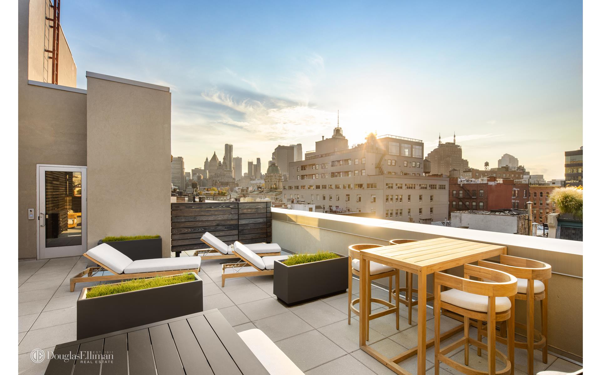 Presenting Penthouse A: The One and Only Four-Bedroom Penthouse Residence at Andre Kikoski & Kravitz Design's NoLita Masterpiece.    Immediate Occupancy at Downtown Manhattan's best selling New Development, Final Residences Remain. Offering limited in-person and virtual appointments and 50% off parking for 10 years for select purchasers.    Staged in collaboration with Ligne Roset & Modernist Cuisine Gallery, Penthouse A offers the best of indoor and outdoor living in Downtown Manhattan. Spanning over 3,017 SQFT with an additional 2,275 SQFT of exterior living across a private terrace and roof   deck, this unparalleled four bedroom, four-and-one-half bathroom penthouse is truly the best NoLita has to offer.    Upon entry, stunning white oak hardwood floors lend way to the 45 long great room, with a curtain wall of floor-to-ceiling windows offering exceptional city views and abundant natural light. The open concept living and dining wing boasts a board-form concrete   surround fireplace, stunning white oak floors and a curtain wall of floor-to-ceiling windows. Just outside, the first of two private outdoor spaces awaits with a 1,170 SQFT private corner terrace overlooking Downtown.    The well-appointed kitchen suits any level chef, fully outfitted with a suite of Gaggenau appliances, marble floating island with a custom oak bar top accented by a rear pewter topped counter, marble backsplash, matte-white cabinetry and two integrated oak   paneled refrigerators. Just behind the kitchen youll find a 6 x 5 pantry for all your cooking essentials, and adjacent staircase leading up to the private 1,105 SQFT sun deck sun deck equipped with a BBQ grill. On the other side of the kitchen, a large laundry   room with LG washer and dryer included provides convenient space for storage.    Adjacent to the foyer, a jeweled powder room with a custom elm floating vanity with Bianco drama marble countertop and sink complements the backlit, illuminated satin nickel framed mirror and Ch