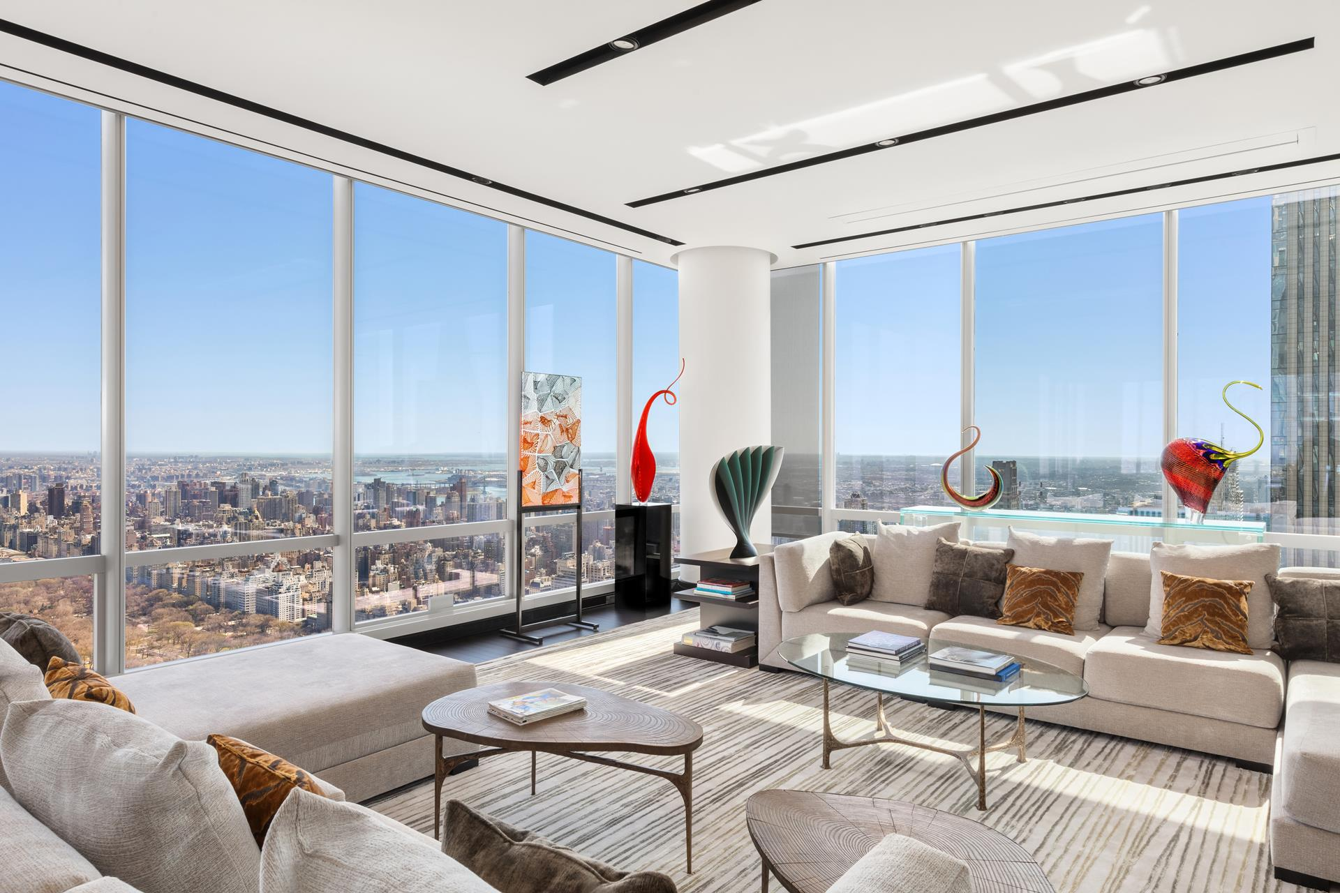 Soaring high above Midtown, comprising the entire 81st floor, this trophy penthouse residence at the premier One57 condominium tower is a masterpiece of design and luxury. From your sprawling private oasis in the sky, you will enjoy spectacular panoramas   from every room & vantage point, with inpouring natural light all day long. Walls of glass wrap the entire home, capturing unobstructed expanses of Central Park, the Hudson River, East River & dramatic cityscapes.    Offered for those with uncompromising taste, this 4 bedroom, 4.5 bath jewel exudes elegance with the finest fit & finish, and dimensions of grand proportion. Upscale details abound throughout including museum-grade lighting; abundant wall space for   art; soft-close pocket doors for uninterrupted walls & pathways; concealed motorized solar & blackout shades; heated stone bathroom floors; a Smart Home which includes a Crestron system for lighting, AV, shades, security & HVAC control; even a safe room with   ballistic board lining the walls & door.        A private elevator landing opens to a gracious entry foyer, spilling into a glamorous great room for entertaining. Surrounding you are incredible vistas from a generous open layout that affords versatile seating arrangements. Unique concealed ceiling-mounted   TV screens with high-quality projectors in the living/dining areas thoughtfully maintain the sweeping views of Central Park & NYC. The exquisite chef's kitchen is beyond compare, styled with custom cabinetry, top-of-the-line appliances, a custom hand-made   ceiling-hung lighted pot rock & sunny breakfast room overlooking the Hudson.    A long gallery hall proceeds to the sleeping quarters offering 3 spacious bedroom suites with high-end baths & ample closets. A separate sitting room/office niche is also nearby with wonderful views. Past the laundry room, in its own secluded wing, sits the   stunning primary bedroom suite for the ultimate pampered experience. An enormous dressing room with custom 