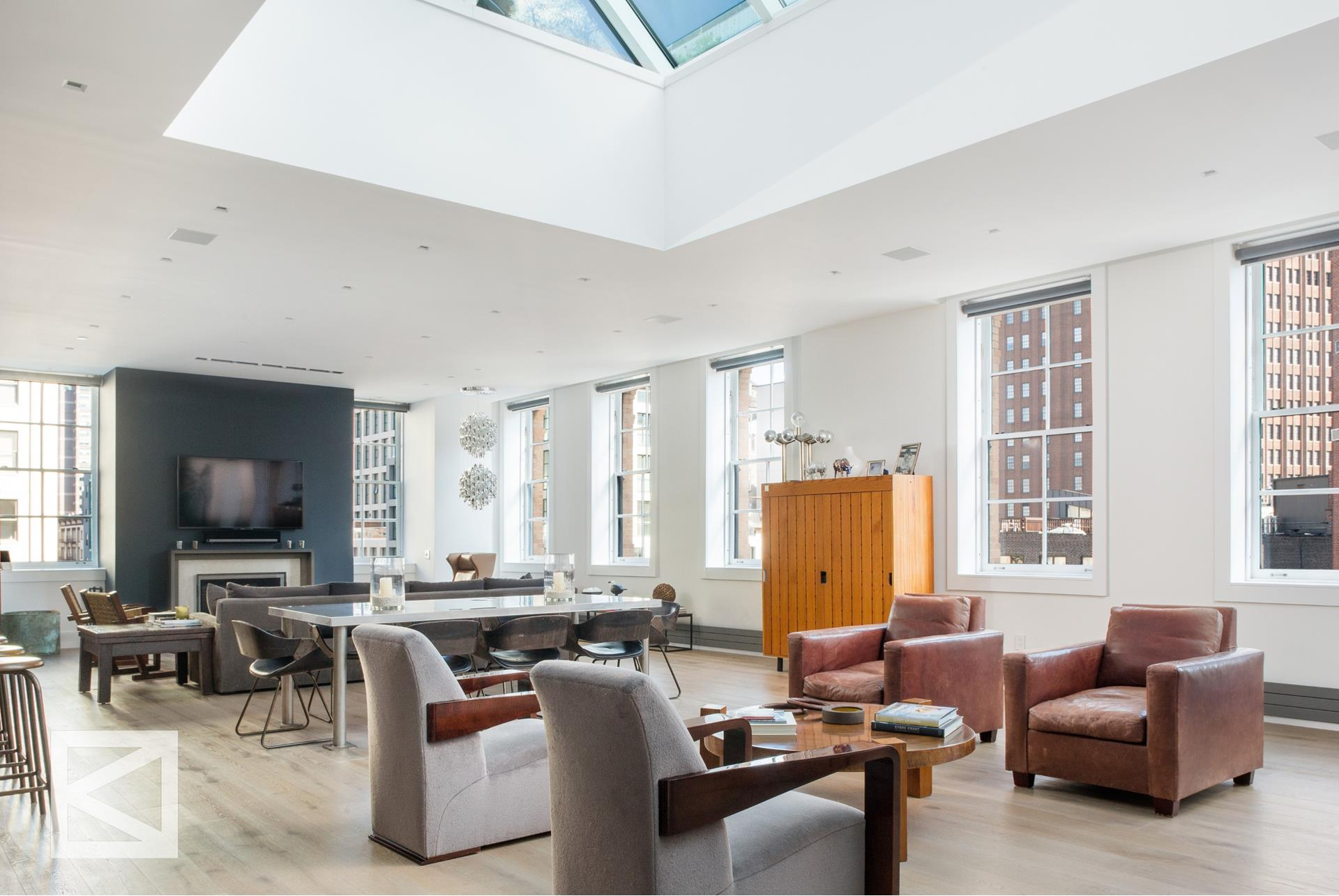 This rare and important pre-war loft condominium, built by Albert Wagner in 1887, offers 12 exclusive lofts. Encompassing the entire top 2 floors of this building. A premier penthouse offering 4 bedrooms (currently configured as a 3 bedroom) and is situated   in an ultra-discreet building that offers onsite staff and a full-time doorman.This loft spans over 4,000 sq ft feet of interior living that is intelligently designed and exceptionally renovated. A sophisticated private outdoor terrace that is just over 1,650   sq ft showcasing a fully landscaped layout to include: a grilling / cooking preparation setup, a separate private dining section, alongside a relaxed sun-filled lounging area. This exterior component provides room for entertainment with privacy and has magical   views of the New York City Skyline that stretches the entire West and Southern portion of Tribeca. Renovated to the highest standards by interior designer Robert Stilin, this modern custom home is sprawling, refined and understated. With 9 deep set windows   that span the entire length of this great room, tremendous light floods into the residence from all directions. A superb layout that is ideal for both grand entertaining and laid back living. All grounded by a real wood-burning fireplace that is set apart   by an immense architectural skylight that sits high above this duplex loft. The chef-level kitchen is impeccable, and located right off the great room. A preparation station that is in excess of 15 feet, complimented by French custom stone countertops and   custom waxed oak cabinetry by RJ Millwork with hand crafted wrought iron detailing is truly stunning. This kitchen is fully equipped and outfitted with 3 dishwashers, a wine refrigeration system that holds 150 bottles, a Wolf oven, a Miele built in coffee   machine alongside a 48 inch Sub-Zero refrigeration system.     There are three well-proportioned bedrooms located off the great room that are complimented by windowed en-suite bathro