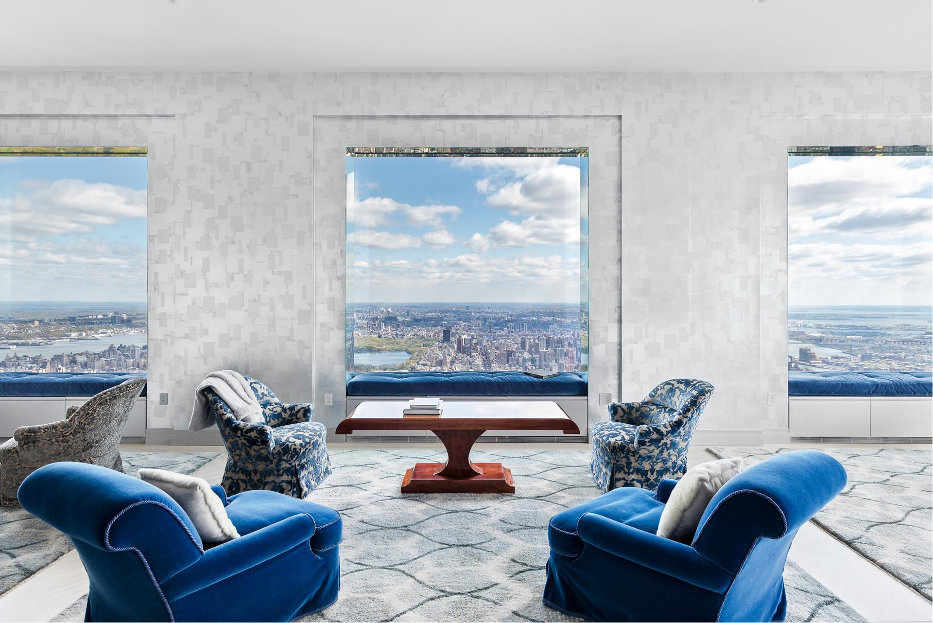 """This residence, located on a high floor of iconic 432 Park Avenue, designed by architect Rafael Violy, has recently been converted from a three-bedroom unit to an elegant two-bedroom home. With a private elevator entry and gallery leading to a grand, corner   living and dining room, this 2,633 square foot high-floor residence offers northern views over Central Park and eastern views toward the East River and beyond, captured in spectacular 10' by 10' windows, under soaring 12'6"""" ceilings. With views to the east,   the eat-in kitchen has a marble floor and countertops, cabinetry of lacquer and natural oak, Miele stainless steel appliances, and Dornbracht polished chrome fixtures. The master bedroom suite features park views, a walk-in dressing room, and a luxurious bathroom   swathed in marble, including marble floors and walls, and cubic marble vanities, while the second bedroom includes an ensuite bath, also rich with marble, and views to the east."""