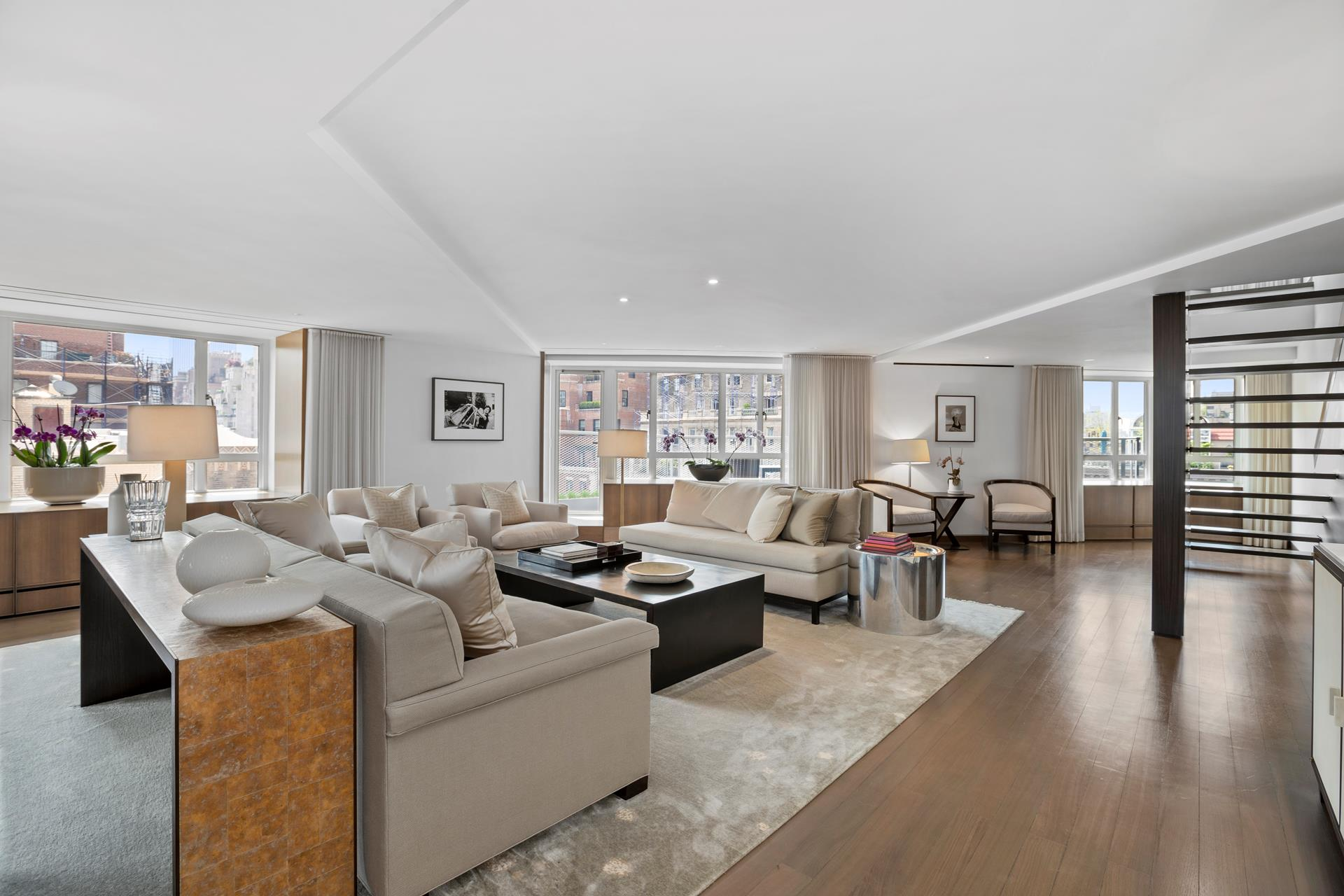 Exquisitely renovated by renowned designer Russel Grove and featured in Architectural Digest, this 5,200 sq. ft. 10-room duplex residence with 705 sq. ft. of private terraces offers gorgeous views of the city, Park Avenue and beyond to Central Park and   the city skyline, and features a sprawling double-living room, a spacious dining room, an expansive dream kitchen with adjacent breakfast room, 3-4 bedrooms, a den and home office, 4 full baths, 1 half baths, and two laundry rooms, located in full-service   building on prime Park Avenue.    An entry foyer with two coat closets and a large Travertine stone powder room welcomes you into an expansive corner double living room with open south and west exposures, and access to a decked terrace with views of Park Avenue and Central Park. There is a   large formal dining room, also with access to its own planted terrace -- which has an automated irrigation system -- and flows seamlessly into a media room and the oversized Boffi chef's kitchen with its spacious breakfast room and a wall of windows with open   north exposures. This dream kitchen features top-of-the-line finishes and appliances, including Calacatta marble counters, custom-built lacquered cabinetry, Gaggenau refrigerator, two side-by-side SubZero wine coolers, two Miele dishwashers, Miele double-oven,   a six-burner Gaggenau cooktop with ceiling-mounted canopy, and a large walk-in pantry with a second refrigerator, SubZero icemaker, and abundant storage.    There is a separate bedroom wing with two generously proportioned west-facing bedrooms with open city views, one with an en suite bathroom decked in Travertine stone floors and vanity, and a large glass-enclosed rain-shower stall. The other bathroom also has   Travertine stone floors and vanity, and a glass-enclosed soaking tub. In addition, there is a large laundry room with motion-activated lighting, Miele washer and dryer, sink, and storage cabinets.    An architecturally designed cantilevered staircase 