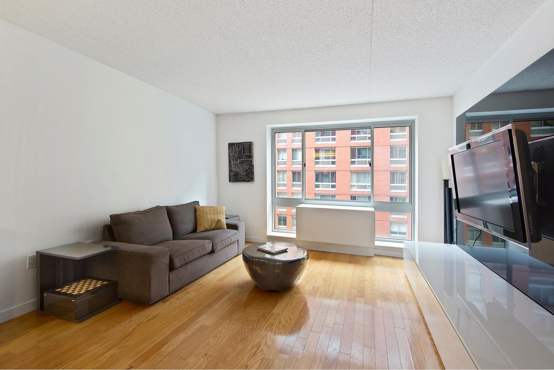 This is a large and sunny one-bedroom, one-bathroom home in a luxury condominium right in the heart of Chelsea. The kitchen has a huge island, granite counter tops, full-sized stainless steel appliances, including dishwasher, cayenne maple cabinetry and   sleek porcelain flooring. The bathroom is surrounded in warm, earth-tone Amarillo stone, three-paneled mirror medicine cabinet, vanity cabinet, and granite sink top. The sleek hardwood floors and private washer/dryer finish off this perfect home.    555 W. 23rd St. is a luxury condominium, with 24-hour doorman, live-in super, on-site property manager and full staff. The amenities are immense with laundry room, complimentary gym, massive courtyard with outdoor furnishings, plantings and fountain, renovated   lobby, two newly-renovated lounges, package room, dry-cleaning and cleaning service, parking garage and bike storage. A new Whole Foods is just a few blocks up, along with tons of restaurants, shopping, CVS (across the street), galleries, the Highline, Hudson   Yards a few blocks north and Chelsea Market a few blocks south. Hudson River Park is right across the avenue with parks, bike and running trails, dog park, soccer field, and Chelsea Piers. This is a pet-friendly building and neighborhood.
