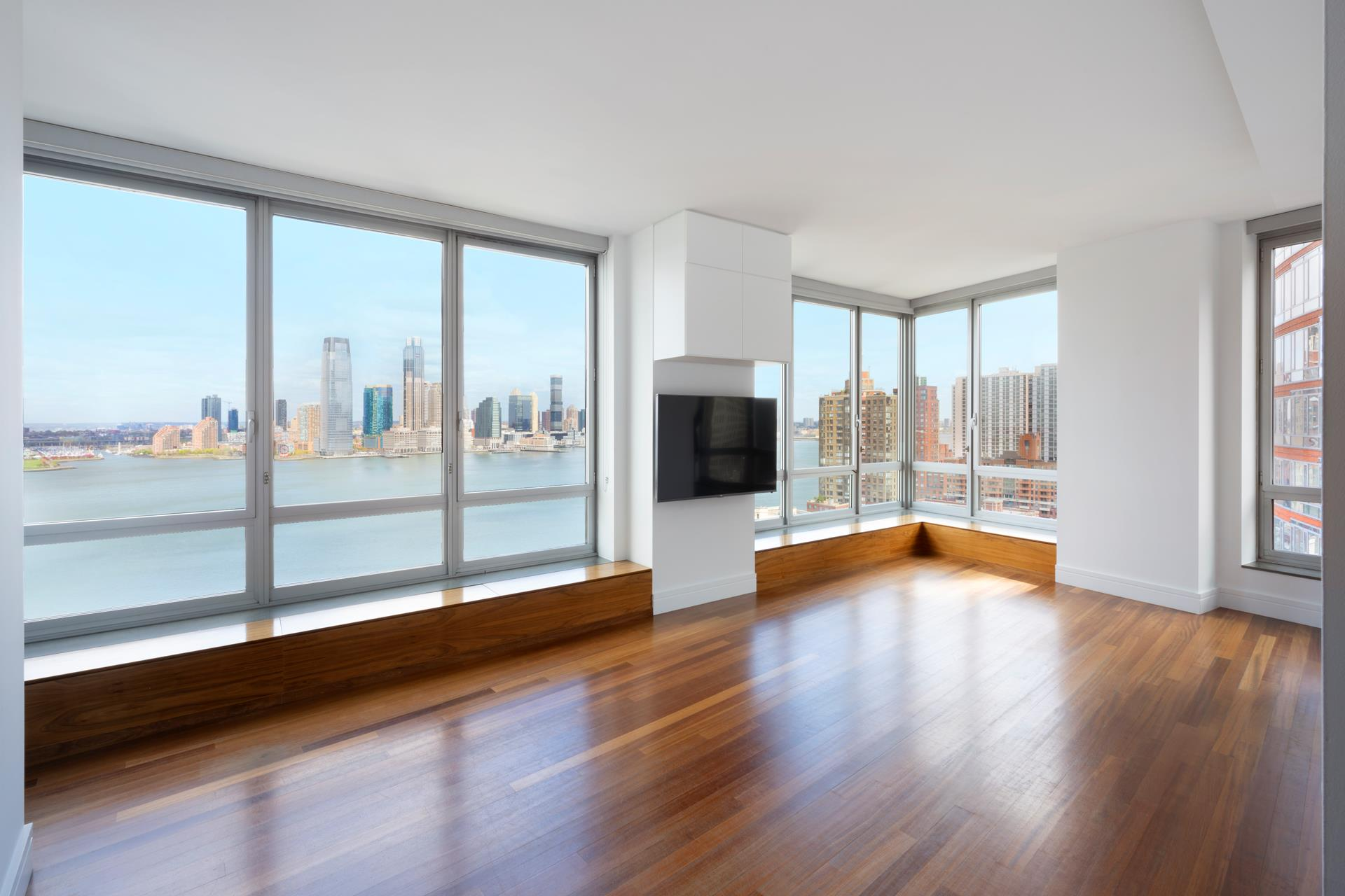 Welcome home to this spacious 5-bedroom, 5.5-bathroom condo with panoramic river and city views that feature the Statue of Liberty, Hudson River, and One World Trade. The living room includes breathtaking views and custom seating along the windowsill,   perfect for taking in cinematic sunsets, and an expansive wet bar makes entertaining a breeze. The chef's kitchen, which is open to the family room, boasts a private balcony and is appointed with top-of-the line appliances, including a Sub-Zero refrigerator,   Miele dishwasher, Viking gas range, and U-line wine cooler. The spacious primary bedroom has direct river views, en-suite bathroom with a double vanity, soaking tub and frameless glass shower, and a walk-in closet. Four additional bedrooms each have en-suite   bathrooms. Other apartment features include an in-unit washer/dryer, Brazilian cherry wood flooring, and an entry with custom built-ins for coats and shoes.    30 West Street includes a state-of-the art fitness center, resident lounge, kids' club, 24-hour concierge, doorman, and live-in resident manager. This coveted residence is conveniently located in Battery Park City adjacent to numerous parks and promenades,   Pier A, and Brookfield Place.