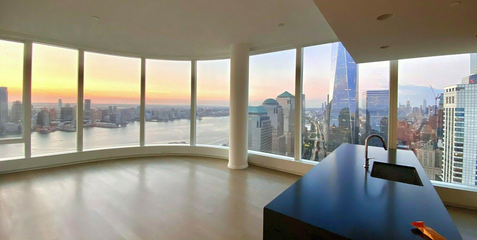 Enjoy breathtaking scenic views in this spacious two bedroom, two bathroom high-rise apartment. Located on the 52nd floor featuring curved floor-to-ceiling windows throughout the entire residence create panoramic bright views of the Manhattan Skyline showcasing   iconic New York landmarks including the Statue of Liberty, Hudson River, Battery Park, and One World Trade. Bright Master Bedroom facing West, overlooking the New York Harbor's iconic Statue of Liberty. The master suite features multiple closets and a spa   designed en-suite bathroom with double, marble vanity, radiant floor heating, glass rain shower and separate soaking tub, and high-end finishes such as Toto and Hansgrohe. The unit also features a walk-in closet that can be converted to an office or second   bedroom, and an in-unit washer and dryer. 50 West, a 64-story residential tower located in the center of the New Downtown, features unparalleled views of the New York Harbor, the Hudson and East Rivers, the Statue of Liberty, and Ellis Island. Internationally-acclaimed   architect Helmut Jahn has designed the approximately 780' skyscraper to feature floor-to-ceiling curved glass windows. The expansive interior layouts, ranging from one to five bedrooms and featuring an array of duplex and double height spaces, were designed   and finished by Thomas Juul-Hansen. Four floors of the tower are devoted to state-of-the-art amenities: an immense Fitness Center, the beautifully-appointed Water Club, unique amenities, and The Observatory at 50 West Street, a spectacular 64th floor outdoor   entertaining space with seemingly infinite views of New York and beyond.