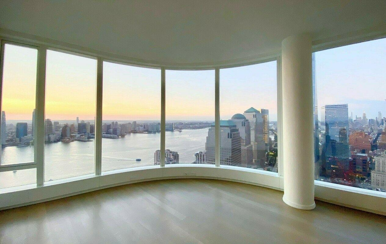 Enjoy breathtaking scenic views in this spacious two bedroom, two bathroom high-rise apartment. Located on the 52nd floor featuring curved floor-to-ceiling windows throughout the entire residence create panoramic bright views of the Manhattan Skyline showcasing   iconic New York landmarks including the Statue of Liberty, Hudson River, Battery Park, and One World Trade. Bright Master Bedroom facing West, overlooking the New York Harbor's iconic Statue of Liberty.The master suite features multiple closets and a spa designed   en-suite bathroom with double, marble vanity, radiant floor heating, glass rain shower and separate soaking tub, and high-end finishes such as Toto and Hansgrohe. The unit also features a walk-in closet that can be converted to an office or second bedroom,   and an in-unit washer and dryer. 50 West, a 64-story residential tower located in the center of the New Downtown, features unparalleled views of the New York Harbor, the Hudson and East Rivers, the Statue of Liberty, and Ellis Island. Internationally-acclaimed   architect Helmut Jahn has designed the approximately 780' skyscraper to feature floor-to-ceiling curved glass windows. The expansive interior layouts, ranging from one to five bedrooms and featuring an array of duplex and double height spaces, were designed   and finished by Thomas Juul-Hansen.Four floors of the tower are devoted to state-of-the-art amenities: an immense Fitness Center, the beautifully-appointed Water Club, unique children's amenities, and The Observatory at 50 West Street, a spectacular 64th floor   outdoor entertaining space with seemingly infinite views of New York and beyond.