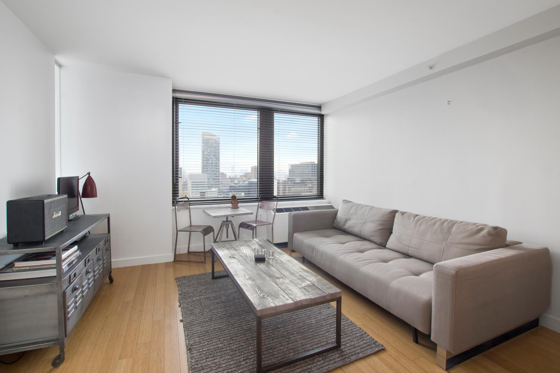 Private showings can be scheduled directly with the listing brokers 7 days a week!    PRIVATE LUXURY CONDO LIVING JUST STEPS FROM BRYANT PARK!    This impeccably designed 1 bedroom, 1 bathroom has tons of natural sun light due to its spectacular breathtaking City Skyline. The apartment features bamboo floors throughout, translucent Italian ice-grass doors, limestone thresholds and a stunning open kitchen   with top of the line stainless steel appliances, polished white marble countertops & oak cabinetry. It also has a spa-like pristine bathroom which has an ivory alabastro porcelain tile floor, zuma collection square tub with watermark hardware.    Bryant Park Towers is located between 7th & 6th avenue and is just a few blocks away from the 1/2/3/4/5/6/7/S/N/Q/R/W/B/D/F/M subways & QM1, QM3, QM4, QM5, Q32, M42 buses.    Enjoy living in the heart of New York Citys Hot Spot where youll find great restaurants, museums, shopping, health clubs, movie theatres, libraries & much more This fabulous high-end condominium is even walking distance from the famous, sought-after & splendid   bryant park where one can enjoy the comfort of its quiet and relaxing lush gardens. You can have ALL that while being surrounded by the very best services and luxuries this city has to offer!    The amenities are: FREE Fitness Room, Laundry Room, Designer Lobby & Mail Room, Full-time Doorman, Concierge Services, Parking Garage & Live-in Superintendent.