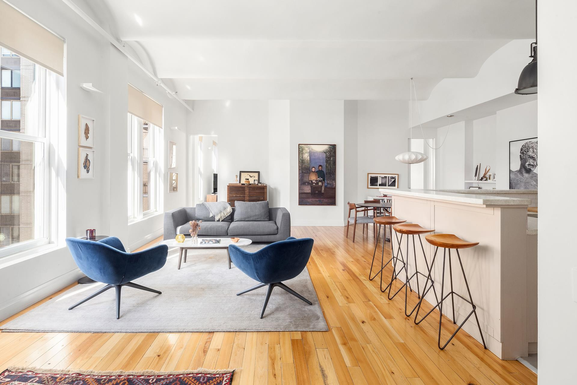 Rarely available, this light-filled 2000 SF beautiful loft with 11' vaulted ceilings and attractive reclaimed elm floorings is situated on the prettiest tree-lined block in the Flat Iron district.. A unique full floor 3 bedrooms and 3.5 baths boasts superb   views, from three exposures, of some of Manhattan's venerated architecture. The generously proportioned great room offers ample space for dining and lounging and has stunning sunset views and it adjoins a spacious open kitchen with stainless steel appliances.   The oversized master bedroom suite with library and sitting area overlooking a planted garden and includes two large walk-in closets and a spacious en suite bath with separate tub and shower. Facing north are two smaller bedrooms with en suite bathrooms and   views of MetLife Clock Tower and Empire State Building. The apartment also has an over-sized laundry room two additional closets and a powder room. The building offers video security and the super is onsite weekdays. Neighborhood attractions include Madison   Square Park, Eataly, Union Square Farmers Market and many of the best restaurants in the city. . Ultra convenient to transportation. This mint, fully renovated home is not to be missed!