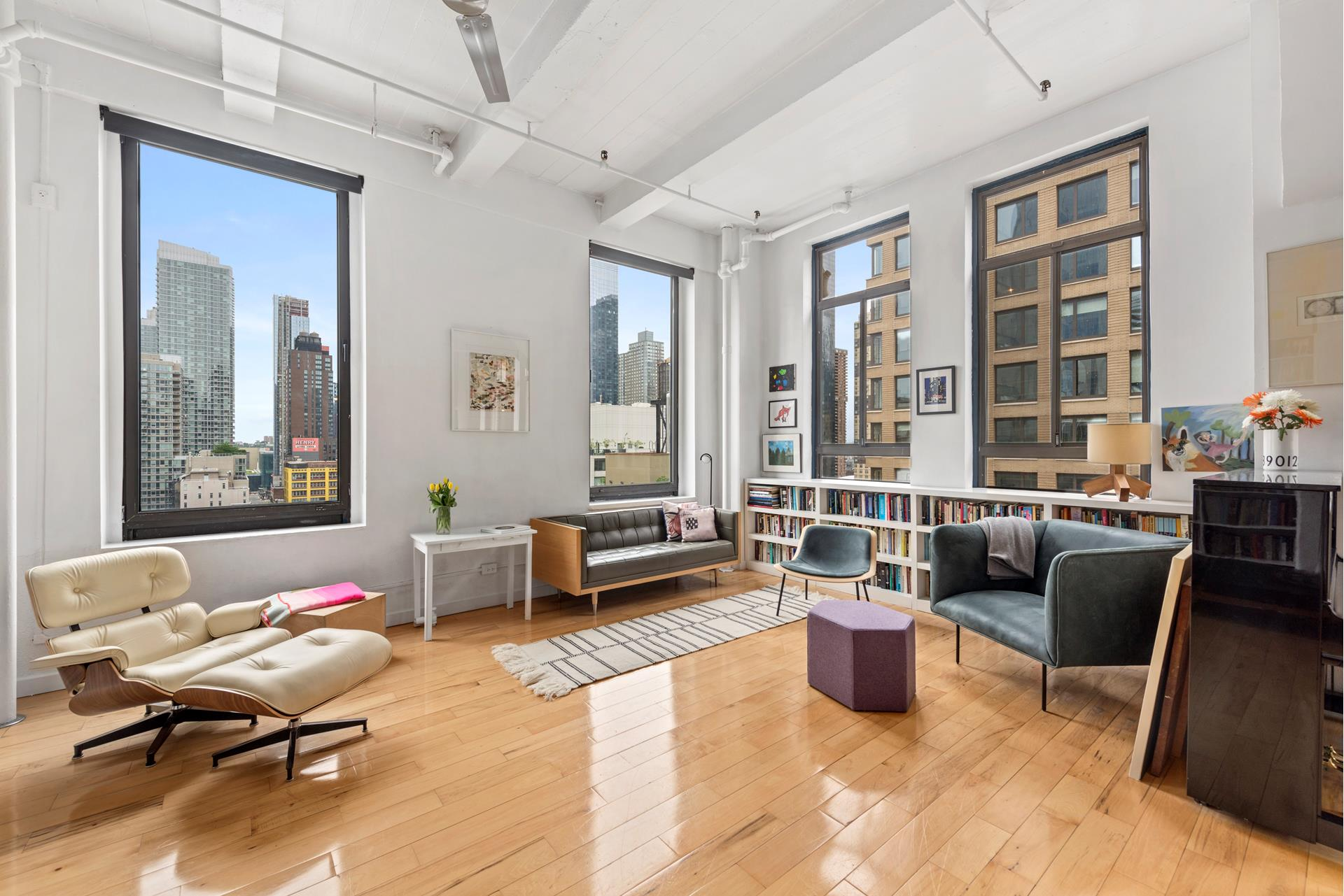 SUNNY HUDSON YARDS LOFT!       Spacious, light-flooded loft with spectacular river views in the heart of a booming Manhattan neighborhood. This apartment features soaring12 feet ceilings and 8 feet windows, oak floors,two   beautifully designed sleeping areas, and a charmingly informal kitchen with a Wolf oven and a Fisher-Paykel dishwasher. With its dramatic and expansive living space, this is a unit that must be seen to be appreciated. All of its details-the ships   bunks, the large storage attic, the custom shelving, the underbed cargo spaces-combine to create an extraordinary spatial efficiency and luxury.    This unique property is the 10th-floor corner unit of an elegant 1915 building on the western fringe of the Garment District. It offers an exceptional opportunity to live a dream New York lifestyle in a creative, thriving neighborhood filled with dance venues,   recording studios, theatres, coffee shops and restaurants. The apartment is perfect for entertaining, domestic tranquility, and creative inspiration. Hudson Yards, the High Line, the new Hudson Boulevard greenway, the Baryshnikov Arts Center-these and many   other diversions are within strolling distance. Shop locally at Brooklyn Fare, Esposito Meat Market, Ninth Avenue International Foods, Gotham West Market, and any number of beloved family-owned businesses.    Enjoy stunning views of the sun setting over the Hudson River. The co-op occupies the seven uppermost floors of a former printing press building. It has an Art Deco lobby, a key-locked elevator, intercom security, and two communal laundry rooms.  Pets are very welcome.   Pied a Terre allowed.  The building has excellent financials, there is NO underlying mortgage.  The co-op is under a proprietary Master Lease until December 31, 2179.