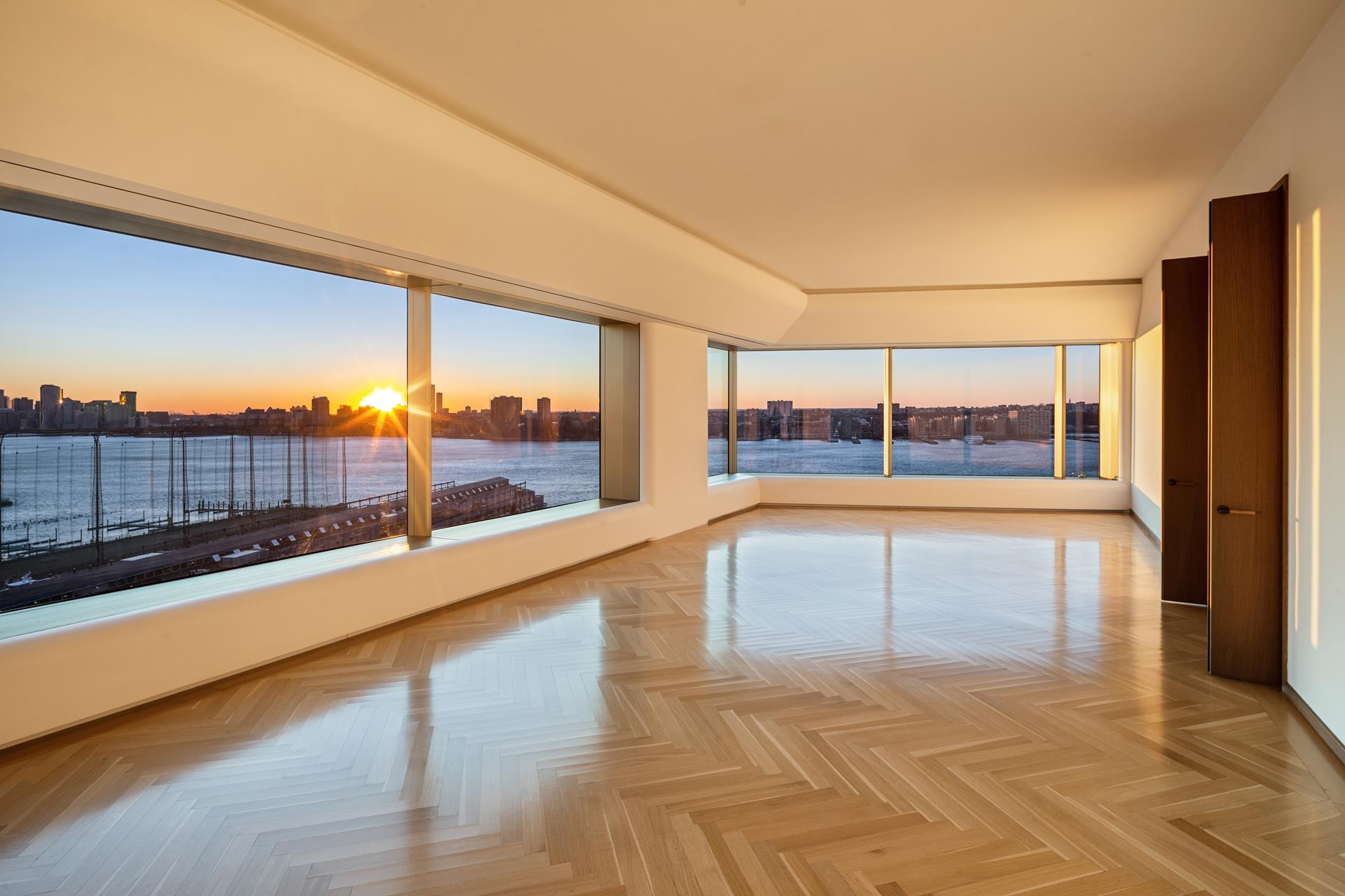 RARELY AVAILABLE HIGH FLOOR A-LINE 4 BEDROOM, 4.5 BATHROOM WITH SWEEPING VIEWS OF THE MOST SOUGHT-AFTER ICONIC NEW YORK CITY AND HUDSON RIVER.    Residence 15A is offering 4,271 sq ft of private living with 11' floor to ceiling dramatic windows that maximizing light and views. The 965 sq ft corner great room on the waterfront offers Statue of Liberty and Verrazano Bridge views. The smartly situated adjacent   dining room flows gracefully in to the Eat-in Chef's Kitchen overlooking the Hudson River. Kitchen features include custom Molteni natural stained oak cabinetry with a hand selected beveled Blanco de Macael marble slab countertops and backsplash. Top of line   appliances are fully integrated including Subzero, Gaggenau, Miele.     The large-scale corner Primary Bedroom suite on the waterfront offers spectacular Hudson River and Midtown skyline views. This generous bedroom includes an oversized dressing room with built-in custom closets by Molteni and a lavish windowed spa bathroom with   deep soaking tub, radiant heated Luna Black granite floors, double custom Corian vanity with integrated lighting, large stall shower, and separate water closet. The additional spacious 3 bedrooms also offer New York City Landmark views and features en-suite   windowed bathrooms with Travertino Striato stone and gracious Dornbracht fixtures. This home also has a professional laundry room.    Parking Available.     Amenities include a private, gated drive court surrounded by a twenty-foot green wall and a dramatic, awe-inspiring thirty-four foot, double height lobby. Additional amenities include full-time doorman, concierge, porter and valet services, a state-of-the-art   fitness center with a his and her spa, yoga room, residents' lounge, children's play room, bike storage, a live-in super and a dedicated, separate service entry.    Note: Unit 15A and 15B are currently configured as a combination and will be legally separated. All taxes and common charges are approximate.