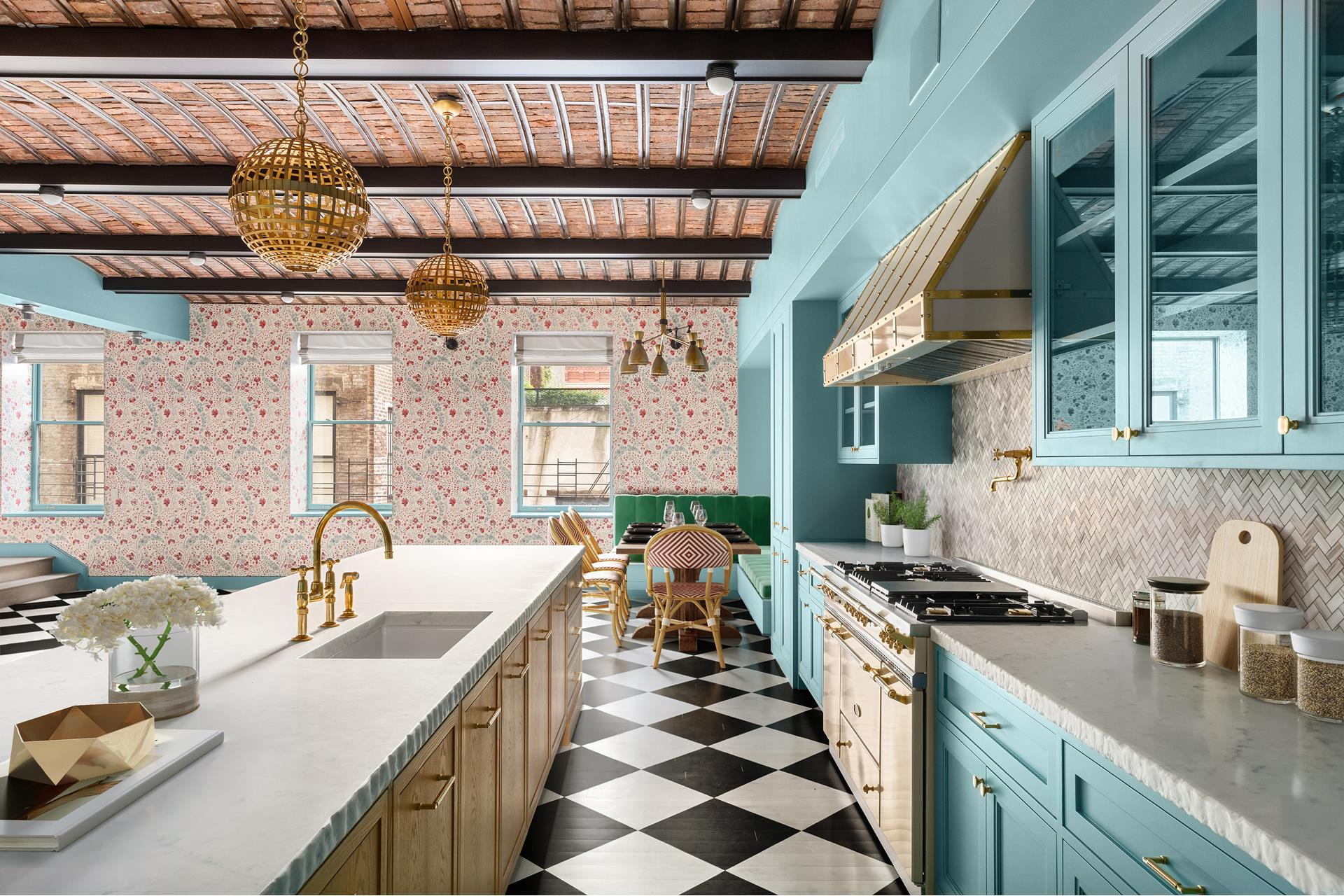 """This luxurious urban residence, in a Pre-War Beaux Art building in a very special part of SoHo, was designed by the internationally recognized interior designer Ken Fulk, a member of the Architectural Digest 100. Described by Fulk as """"Part city townhouse   and part country manor house,"""" the impressively scaled, 6,014 square foot duplex provides an ultra-rare opportunity to own such a sprawling apartment in the epicenter of SoHo.    Replete with historical details, such as original barrel vaulted ceilings, the home has two massive, open-plan living spaces, connected by an elegant internal staircase. Entries and service entries are provided on both levels. As Fulk says, """"Warm wood tones   with accents of brass, glass and marble complement the industrial history of the neighborhood."""" On the lower level, the great room offers an informal living area and eat-in kitchen, with warm, wirebrushed oak millwork, wide plank floors, and richly hued botanical   fabrics. On this level, three family bedrooms have light, happy tones, each with a private bath and copious closet space. An additional full bath is offered for guest use, and a laundry room is also provided. The upstairs level is more urbane, or """"citified""""   as Fulk describes it, with chevron floors and Art Deco detailing in deep green lacquered wood paneling with brass and glass accents. This is the more formal level, with room for formal living and dining areas, with a built-in marble swathed buffet. A wet bar   is provided near a second, enclosed kitchen, provided for ease of entertaining. A powder room is also provided for convenience. Behind the staircase, the master bedroom offers a luxurious walk-in closet and large bath. An adjoining bedroom, with its own walk-in   closet and bath, can also be used as a private sitting room or office.    Harmoniously blending the boutique nature of old-world Soho expected in New York, 151 Wooster is one of Soho's premier locations. With no shortage of world-class shopping and dini"""