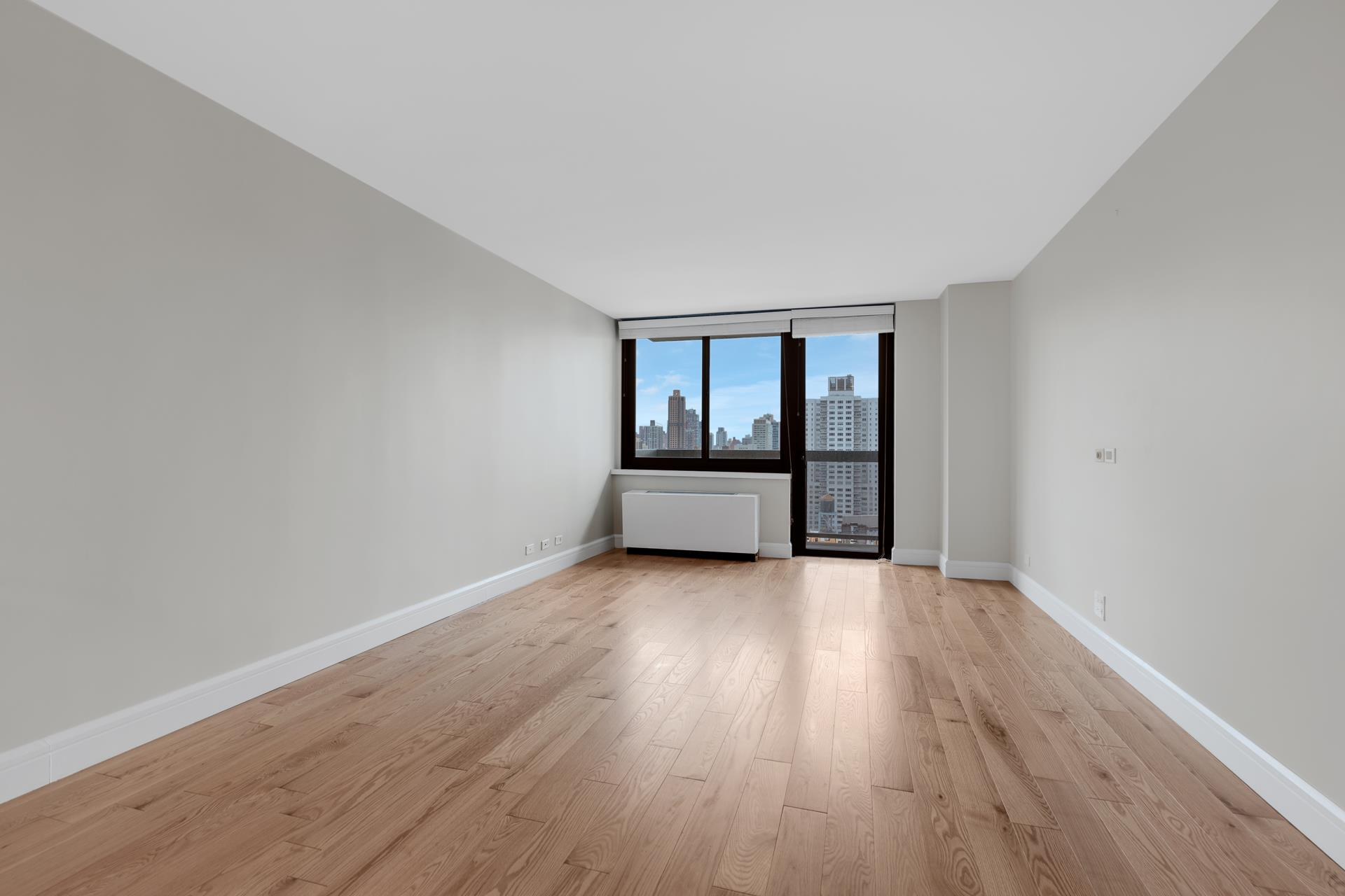 MINT CONDITION 1 bedroom with East river views. The full-service luxury building has a doorman and concierge and offers a lifestyle spa, fitness and wellness facility (including an indoor pool with lounge/game room, rock climbing wall, basketball and squash   courts with weekly and all inclusive classes and workshops, hot tubs, sauna and steam rooms, and a 20,000 square foot private park). The apartment has a balcony off the living room, which features natural walnut floors. Excellent light from a Northern exposure   offers views of the East River. The custom kitchen is accented with walnut and lacquered cabinetry, Corian countertops, Basaltina lava stone backsplash, and top-of-the-line Miele, Thermador and Leibherr appliances including a dishwasher. Great closet space   throughout, as well as an ensuite Bosch washer and dryer. The bathroom walls are made of custom-designed crema dorcia bamboo-textured and honed Piombo tiles with a Zuma soaking tub and Watermark fixtures. The Second Avenue subway and express buses zip you   to every part of the city. Building Features: Doorman, Concierge, Security system, Courtyard, Garden, Roof deck, Pool, Health club. An assessment of $293.26 is in effect through October-2021.