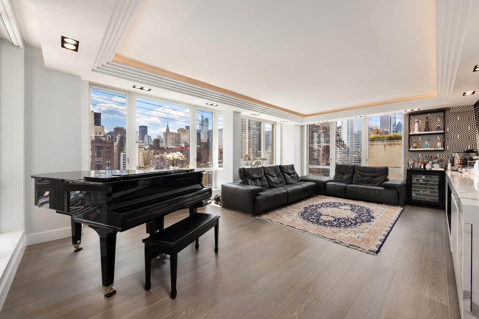 """Two of the most desired lines at Bridge Tower Condominium were masterfully merged and transformed creating a seamless combination and flow after a meticulous renovation to create every modern convenience and elegant standard of living for every Manhattan   homeowner.     A large entrance foyer, high ceilings, stunning moldings, a 35-foot long East, South & West-facing living and dining room delivers the ultimate backdrop for entertaining and daily living. 4 bedrooms, 4.5 bathrooms and an outstanding 2822 square feet of living   space and additional work-spaces are the beginning of what you have to look forward to.    Smart home technology that enrich the modern and luxurious ambiance comes complete with Cat6 networking wired throughout, an IT closet with a Sonos system and Nest Smart thermostats along with Nest Smart co2 smoke detectors. The Somfy electric wired shades   on all windows are sun sensor controlled which automatically lower if the sun is too bright. They can also be easily adjusted with your Smart phone or remote control.    Enjoy exceptional sunlight provided by the dramatic South, East and West exposures which deliver sweeping views from your new floor to ceiling windows where one can see downtown Manhattan, the East River, the Chrysler Building, the Manhattan skyline and the   Queensboro Bridge.     And there's so much more! Select European white oak floors, 7"""" wide and 7 ft. long. Trimless LED lights in the ceilings throughout the entire home, and vent less built in 46"""" ethanol fireplaces in the living room and master bedroom. All bathrooms have full   height stab porcelain walls and floors along with Smart toilets. Custom cabinetry in all bedrooms and closets, HVAC covers and bathroom vanities were all imported.    The windowed sleek Chef's kitchen is impeccably appointed with custom cabinets imported from Europe and made of riff cut white oak, Wolf 4 burner and center infrared char broiler, Wolf ceiling mounted outside venting hood, electronic pus"""