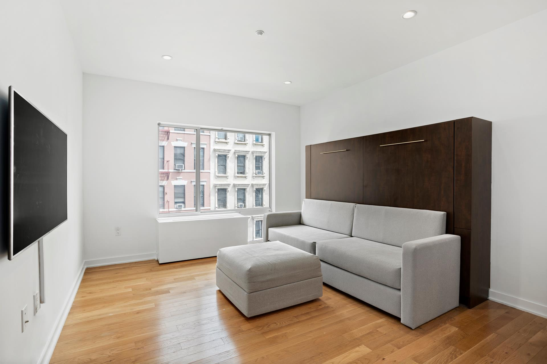 Offered is a roomy street facing one bedroom apt in mint condition at Embelesar 118 in East Harlem. Boasts an entrance foyer, 8 foot 6 inch ceilings, oak floors, an open kitchen equipped with new granite counters & backsplash, a gas stove, a microwave,   a dishwasher, lots of cabinets including 2 Lazy Susans, a food pantry, an in-unit washer/dryer, a full bathroom with tub, a spacious living room with built in Murphy bed as well as extra long couch & chaise ottoman; moreover, a flatscreen hookup able to accommodate   a 50 inch television, oversized windows, walled air conditioning & heating units, custom modular closet organizers and lights on dimmers. Vacant and freshly painted!    The building features an elevator, furnished roof deck, a part-time doorman & a virtual doorman, resident super, a gym with adjacent patio, an attached parking garage ($200 per month), storage cages ($26-$40 per month), bike room rack ($10+/- per month), and   a package room with cold storage. Monthly maintenance includes gas heat and cooking gas. 90% financing allowed. NO CURRENT NOR PENDING MONTHLY ASSESSMENTS. TAX ABATEMENT EXPIRES 2032. 170% MEDIAN INCOME APPLIES. GROSS ANNUAL INCOME MUST NOT EXCEED $142,120   FOR SINGLE INCOME OR $162,350 FOR 2 PERSONS COMBINED INCOME. MUST BE A PRIMARY RESIDENCE. NO INVESTORS. Subletting allowed 2 out of 4 years after 2 years of residency. Pet/Dog friendly (2 maximum).    Located across the street from Hunter College's new graduate school of social work. 2 blocks from the #6 subway on Lexington Ave & East 116th Street. One stop to 125th Street's commercial thoroughfare for a host of services including Metro North and Whole Foods.   A short walk/drive to the East River Plaza Mall (Aldi supermarket, Target, Marshall's, Old Navy, Burlington, Bob's Furniture, Costco, Mattress Firm, Pet Smart, Game Stop, Planet Fitness, Applebee's) and the FDR Drive south.