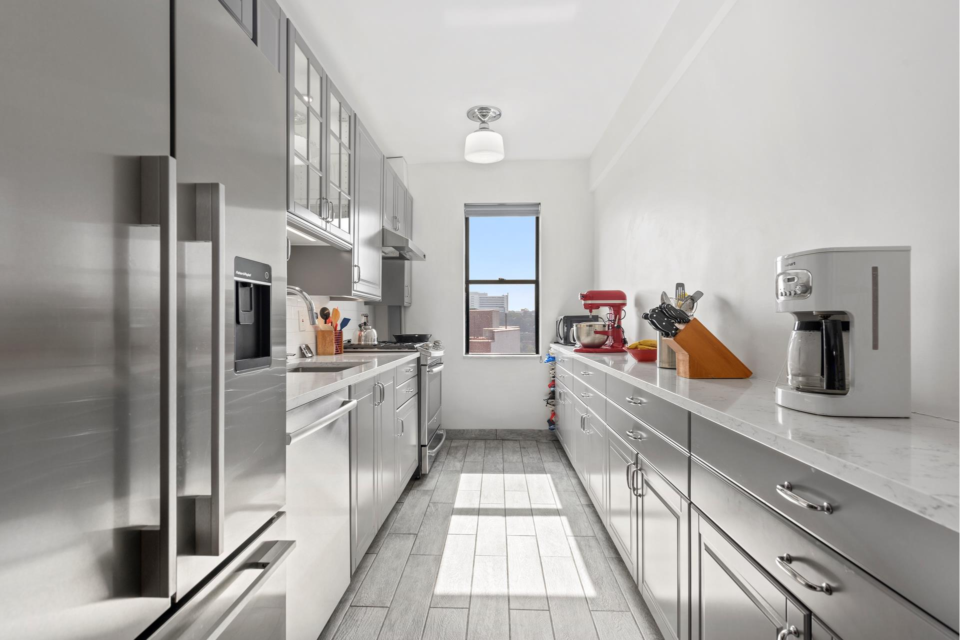 Private showings can be scheduled directly with the listing brokers 7 days a week!    LIVE IN THE HEART OF INWOOD/UPPER MANHATTAN!    This spacious & sun filled one (1) bedroom has been gut renovated/creatively designed while keeping its original pre-war charm/art deco details such as arched walls, beautiful herringbone hardwood floors, high-beamed ceilings & crown moldings throughout. It   includes a custom top of the line windowed kitchen with light grey cabinetry & vintage knobs/pulls, silestone countertops, fisher paykel frigidaire, GE profile gas range, professional stainless steel appliances, deep sink, pull out pantry as well as a bosch   dishwasher. The bathroom has hans grohe shower fixtures, villeroy bosch toilet, robern medicine cabinet, marble tiled floor & a kohler tub.    The apartment also features an elegant entry foyer, custom-made wall-shelving unit, home office area, which overlooks the magnificent/large stepdown sunken living room. Let's not forget tons of large california style closets (4 in total)    Park Terrace Gardens is a well-maintained & financially stable pro-active community complex of ten (10) buildings on 2.67 acres of beautifully landscaped flowering gardens. It was constructed in 1940 of masonry with steel and concrete beams & floors. Each building   has a roof deck terrace with barbeque, private garden, concierge service, bike room & a 24 hour laundry room.    Enjoy living in Inwood/Upper Manhattan where you'll find great restaurants, parks, schools, museums, shopping, health clubs, movie theatres, Columbia's baker athletics complex, Rocco B. Commisso Soccer Stadium, Robert K. Kraft Field, Robertson Field at Satow   Stadium, NewYork-Presbyterian, Isham Park, Inwood Hill Park & Nature Center!    This fabulous property is located on a beautiful tree lined block where residents can enjoy the comfort of a quiet residential street surrounded by the very best services & verdant parkland this city has to offer and so much more!    Park Te