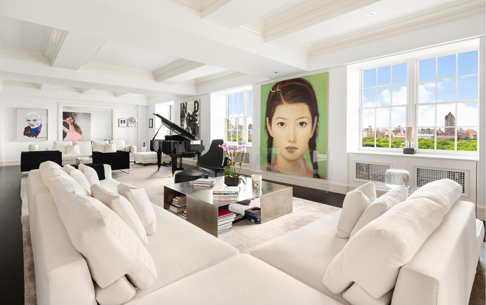 Elegance surrounds you in this expansive full-floor 7/8 bedroom, 9.5 bathroom masterpiece perched on the top story of the premier 995 Fifth Avenue. The former ballroom for The Stanhope, the 16th floor is the only residence in the building that enjoys such   lofty ceiling heights, rising 10 feet in a striking coffered design. Bathed in natural light and finished and restored to perfection, the luxury Upper East Side gem impresses with magnificent views, custom features galore, a specialized home automation system,   and private elevator entry welcoming you into awe-inspiring living space by JANGEORGe Interiors and Furniture. Oversized windows on 4 exposures showcase sweeping vistas capturing Central Park, The Metropolitan Museum of Art, George Washington Bridge, and dramatic   city skylines. Stunning black-stained white oak wood and black antique stone tile flooring enhance warmth and sophistication. Display your fine works of art on generous wall space afforded in the gracious gallery and magnificent 42' great room where entertaining   is divine. This breathtaking open-concept backdrop provides versatility for various living and seating arrangements and is perfect for hosting, complemented by a spacious open dining room in the corner and handsome library on the park. The knockout Smallbone   of Devizes kitchen with a large open breakfast area is not just stylish, but well-proportioned and highly functional, featuring abundant cabinet and countertop space and a center island with seating. Chef's quarters are also appointed with top-of-the-line   stainless steel appliances for the consummate host including Viking ovens, cooktop, warming drawer and range hood, a Subzero refrigerator and wine cooler, plus Miele dishwashers, microwave, and built-in espresso/coffee maker. Your glorious primary suite with   southwestern views, a sitting room with wood-burning fireplace, dressing area and his/her marble-clad spa baths is the ultimate place to renew. Additional bedroom suite