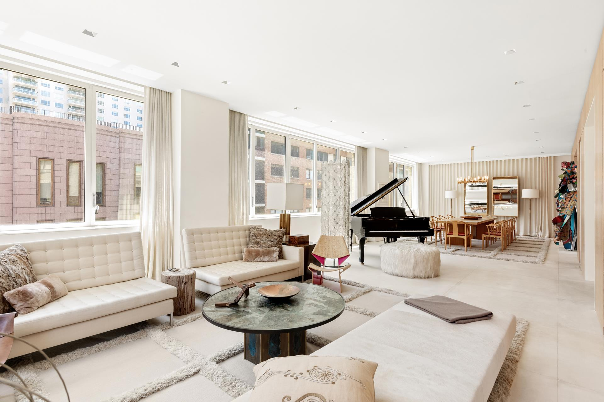 Two meticulously renovated full-floor lofts in a white glove boutique building.    Never before offered opportunity to combine two full-floor lofts, these immaculate apartments would offer 9,300 square feet, 10 bedrooms, 6 full bathrooms, two powder rooms, two outdoor terraces, and TWO PRIVATE DEEDED PARKING SPOTS.    Located in the former home of Christie's East Auction House, now the boutique LOFT67 condominium building, with amenities such as full-time doorman, direct elevator access to your own private parking spot, spacious storage rooms for each residence and concierge   services. Please reach out to discuss further details of this unique combination.