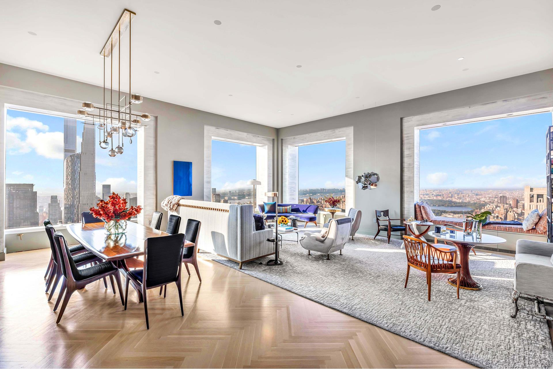 """This incredible residence, located on a higher floor of iconic 432 Park Avenue, designed by architect Rafael Vi oly, offers spectacular views to the west, north, and south. Central Park, Midtown Manhattan, the Hudson River, the Empire State Building, the   New York harbor in the distance, and beyond, are captured in spectacular 10' by 10' windows, under soaring 12'6"""" ceilings. It is a jaw-dropping panorama of the city. You enter the residence, which occupies a full half floor of the building, via a private elevator   entry and gallery, leading to the den or library, and the grand, corner living and dining room.    Joe Nahem an AD100 designer helped create this masterpiece of a home. The eat-in kitchen with views overlooking the city and Central Park has marble floors and countertops, cabinetry of lacquer, Miele stainless steel appliances, and Dornbracht polished chrome   fixtures. There is also a service entrance leading to a small butler's pantry, a laundry room, and a private service corridor offering a discrete connection between the kitchen and bedroom wings of the home.    The master bedroom offers views in two directions of Midtown and Downtown New York, a massive walk-in dressing room, two separate baths swathed in floors and walls of even more marble, and vanities topped with substantial cubic marble slabs. The egg shaped,   free standing tub is perfectly positioned next to the window where one can overlook the sunset with complete privacy. Meanwhile, the second and third bedrooms include ensuite baths, also richly finished, and views to the south.    Rising 1,396 feet above exclusive Park Avenue, 432 Park became an instant New York icon even before completion. Known for its exclusive address, world-class amenities, and innovative design, 432 Park nonetheless stands out most for its views, which due to its   sheer herculean height, allows it to embrace not just all of Park Avenue but also the great expanse of Central Park, beginning two blocks away, in one g"""