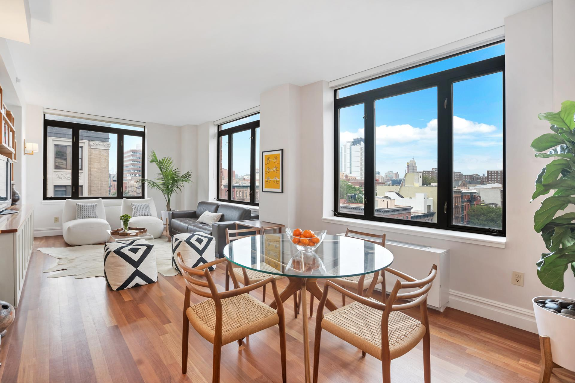"""Available for the first time as a re-sale, this rarely available """"D"""" line corner unit on the seventh floor of The Lenox features Southern and Western exposures, and open city and skyline views.  Tastefully and thoughtfully designed, this special home is no cookie-cutter.    7D is a 3-bedroom (3BR), 2-bath (2BA) located in Central Harlem's premier full-service luxury building, The Lenox.  Lofty, airy and bright, the home has undergone significant upgrades over the past few months: new hardwood floors, new bath rooms, an opened and re-imagined kitchen featuring stainless steel appliances, generous and efficiently planned closets, raised panelled doors to emphasize ceiling heights, a new washer/dryer and plenty more. A toothbrush is truly all that is required to move in!    This is a floor plan that truly """"flows."""" The gracious 9'4"""" x 12'2"""" foyer marks the perfect private entry into the home, with plenty of closets to house your day-to-day needs. This is also where W/D is located. Continuing down the hall, the cavernous primary bedroom   (16' x 11') is set apart from bedrooms two and three and features an en-suite bath and spectacular closet space. The showstopper is the open kitchen and living / dining room featuring both southern and western exposures, overlooking Lenox Avenue. The second   bedroom features a walk-in closet, and is side-by-side to the third bedroom.    The Lenox Condominium was built in 2006 and features a gym, garage, full time doorman and live-in super. There is a tax abatement in place until 2033.  The building is located in central Harlem a few short blocks from Whole Foods and the 2 and 3 express subways.   Sylvia's, Red Rooster and Corner Social are just some of the culinary hotspots located just a few blocks from your future front door."""
