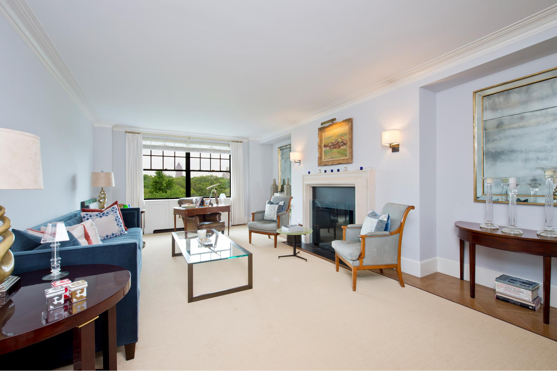 Rare opportunity to combine two apartments in order to create an expansive 12 room home with sweeping Central Park views from 11 windows.     This stunning combination features five bedrooms, five full baths, one half bath, plus two staff rooms. Five Fifth Avenue fronting rooms provide lush panoramic Central Park views extending across to the West Side. Thoughtfully maintained prewar details include   high beamed ceilings, herringbone floors, crown moldings, and a wood burning fireplace.     965 Fifth Avenue is a luxury full service cooperative designed by Emory Roth in 1938. Amenities of this fine residence include attended elevators, a fitness center, additional storage, and a bicycle room.