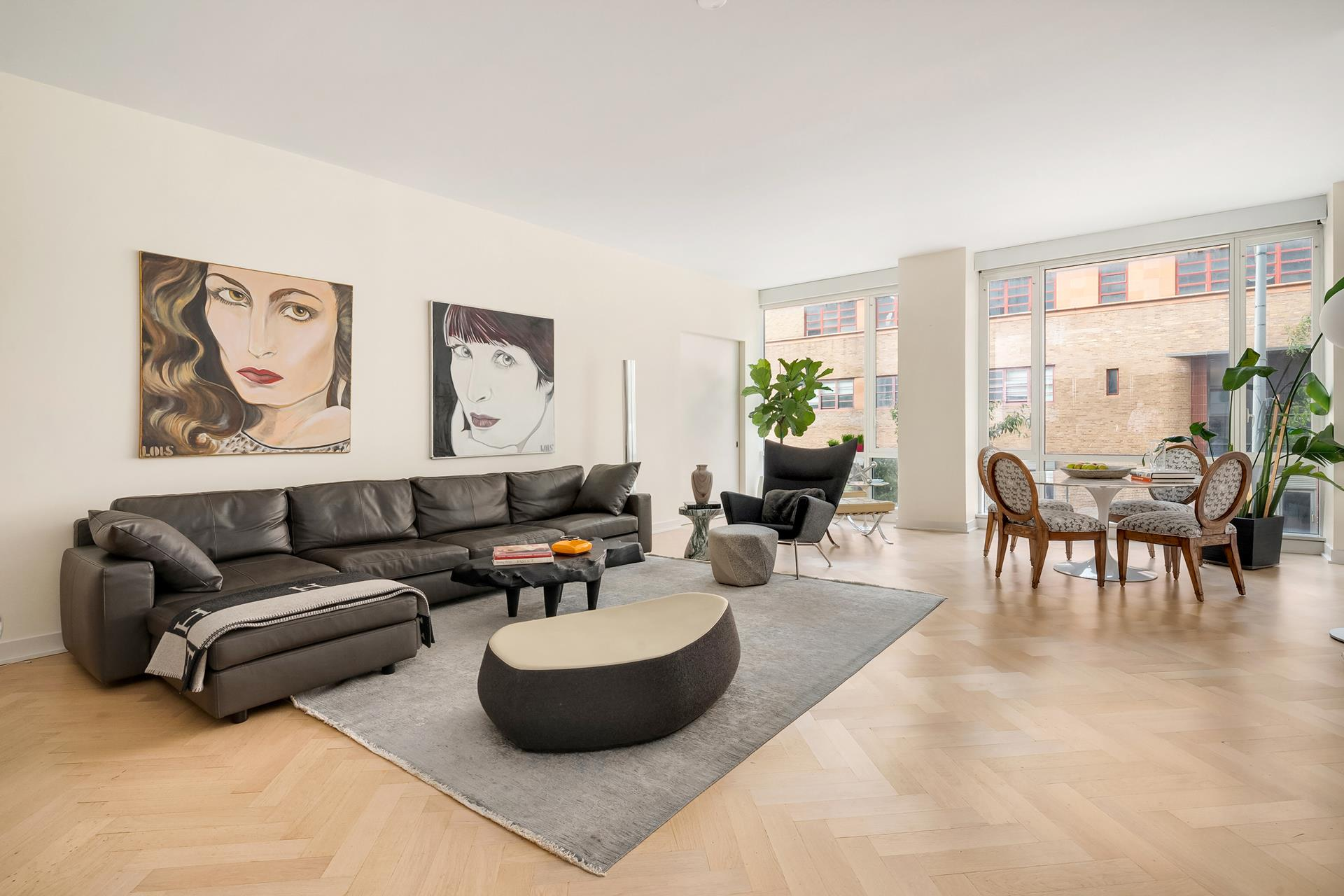 Welcome to the best that West Soho/ Hudson Square has to offer. this expansive split 2BR 2 Bath plus Home Office. This home has been beautifully renovated and features top of the line appliances. Located just steps from the new Google and Disney headquarters this home offers the complete package of size, style, & location!  The Urban Glass House was designed by Philip Johnson as a tribute to his modernist roots. The interiors were designed by renowned architect Annabelle Selldorf, the combination of these powerhouse architects makes this 40-unit condominium building an art form in itself. Urban Glass House is a luxury, well-managed intimate, 12 story condominium. Full-time doorman, superintendent, handyman and porter deliver high quality service. There a well-equipped fitness room and yoga room on the second floor. Additional features include storage bins and bike room. Located in West SoHo a block from Hudson River Park. At the crossroads of SoHo, the West Village and Tribeca, this Spring Street masterpiece is within walking distance to downtown's hippest shopping and restaurants.