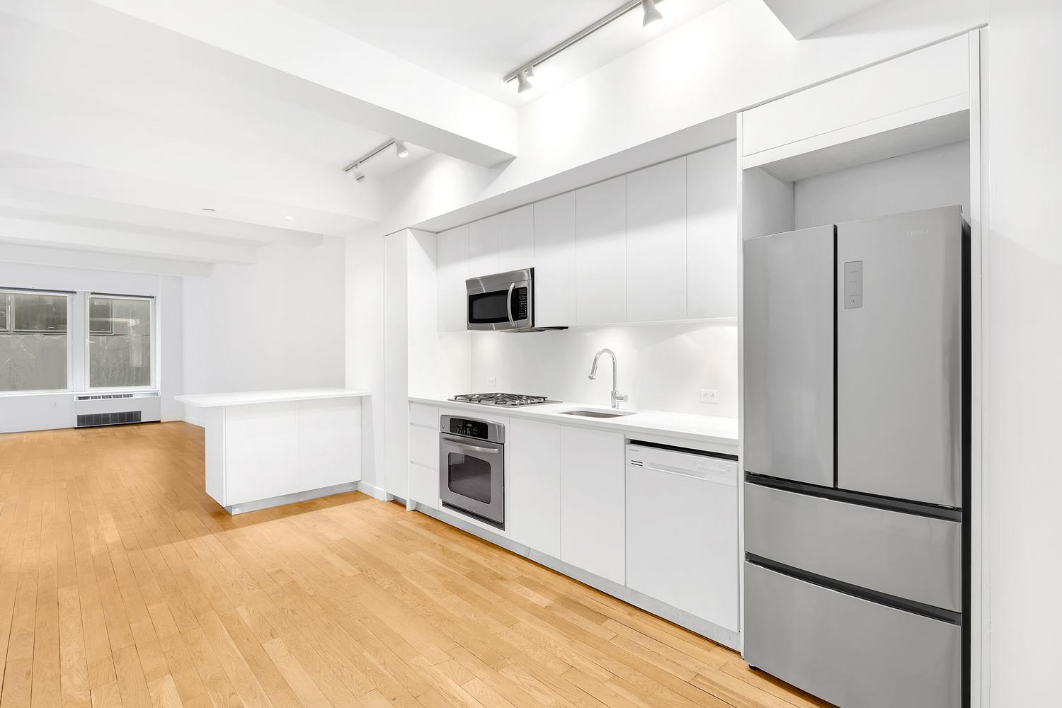 ENJOY THIS STUNNING ONE BEDROOM WITH HOME OFFICE/1100SF FOR $3875.00 PER MONTH!!!.... HUGE 4-Piece Bath. A FABULOUS VALUE...Extra large double paned insulated windows, Solid white oak hardwood floors, Modern open chef's kitchen with white glacier counter tops and custom appliances. The Bath is equipped with Kohler and Watermark fixtures. Up to 9-6 coffered ceilings. Verizon FiOs equipped, phone and cable ready. Elfa closet systems. Building amenities include 24 hour doorman / concierge, be@spot Sky Lounge featuring state-of-the-art entertainment center with billiards table, kitchenette, and an indoor fireplace. Also, the be@spot landscaped outdoor Sky Terrace features a barbeque grill, wet bar and an outdoor fireplace. Rooftop fitness center features Life Fitness equipment with cable TV and Rooftop Laundry Lounge. Located in the heart of the Lower Manhattan Residential Renaissance. Walking distance to WHOLE FOODS, Tiffany's, Tumi, Hermes. 13 train lines. 10 MINUTE WALK TO TRIBECA...A MUST SEE!!!